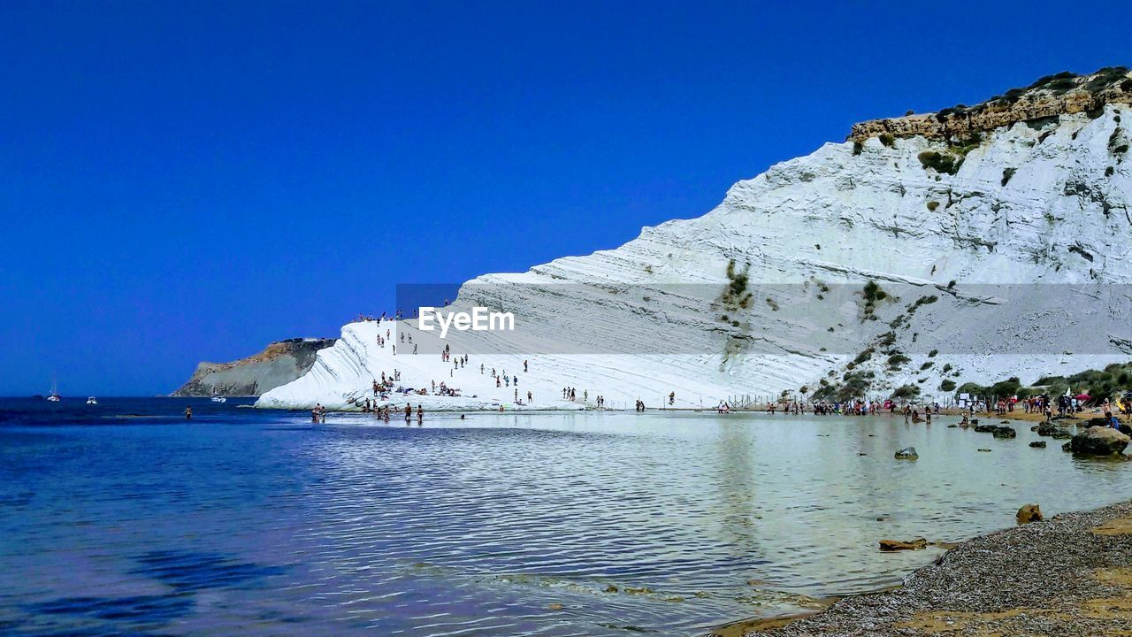 water, sky, clear sky, blue, sea, nature, architecture, day, scenics - nature, beauty in nature, built structure, mountain, no people, building exterior, nautical vessel, copy space, waterfront, building, rock formation, outdoors