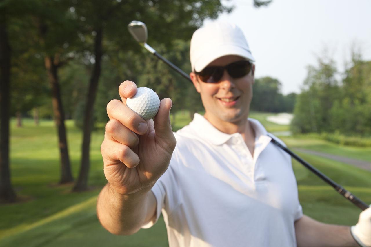 Close-Up Of Man Holding A Golf Ball