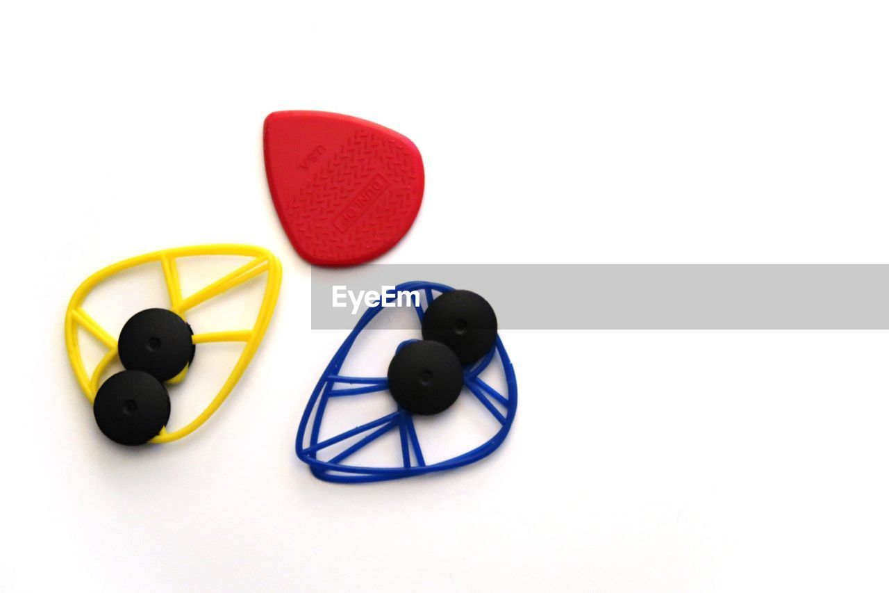 white background, studio shot, copy space, red, still life, indoors, close-up, no people, cut out, heart shape, multi colored, love, blue, high angle view, emotion, positive emotion, shape, creativity, geometric shape, variation