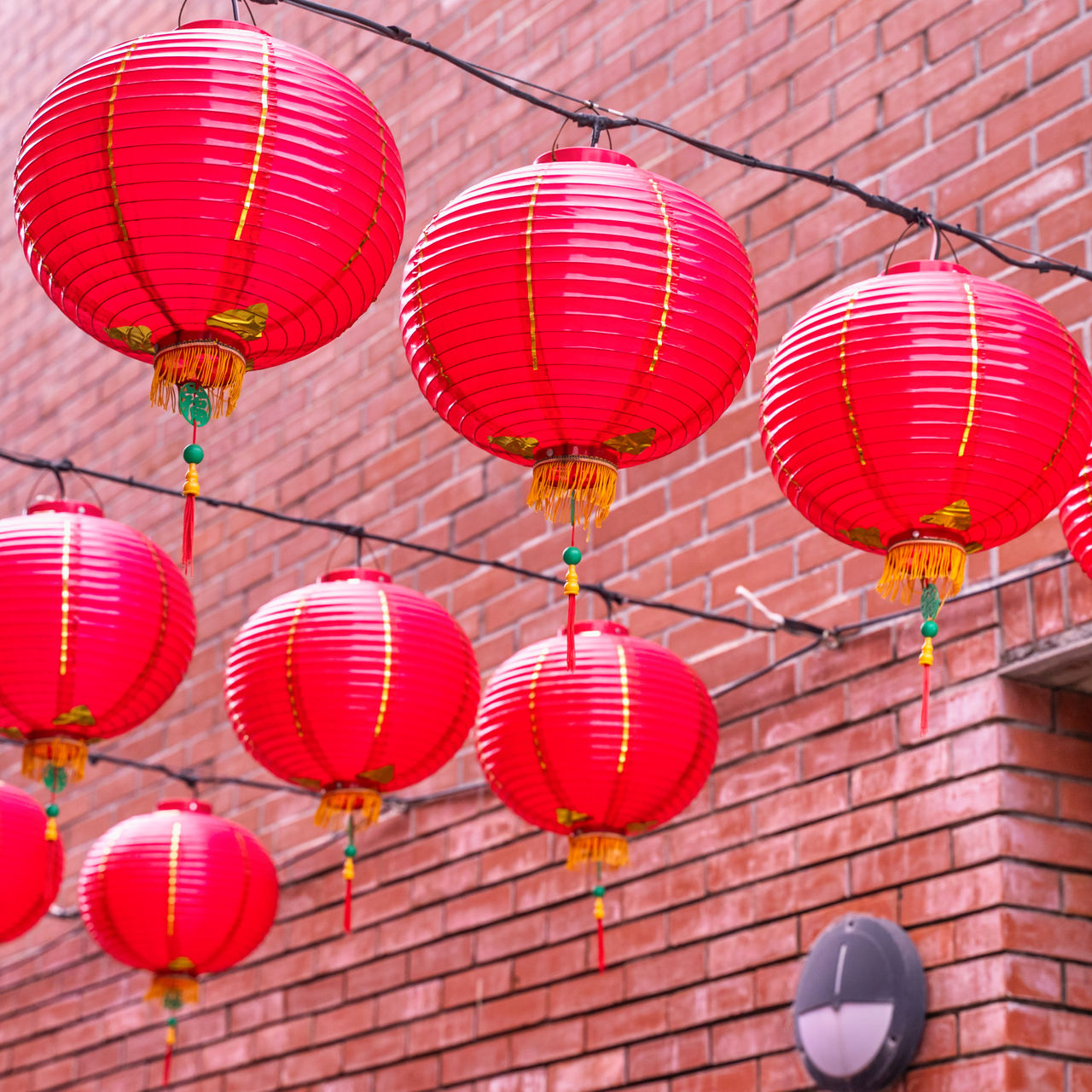LOW ANGLE VIEW OF LANTERNS HANGING BY CEILING