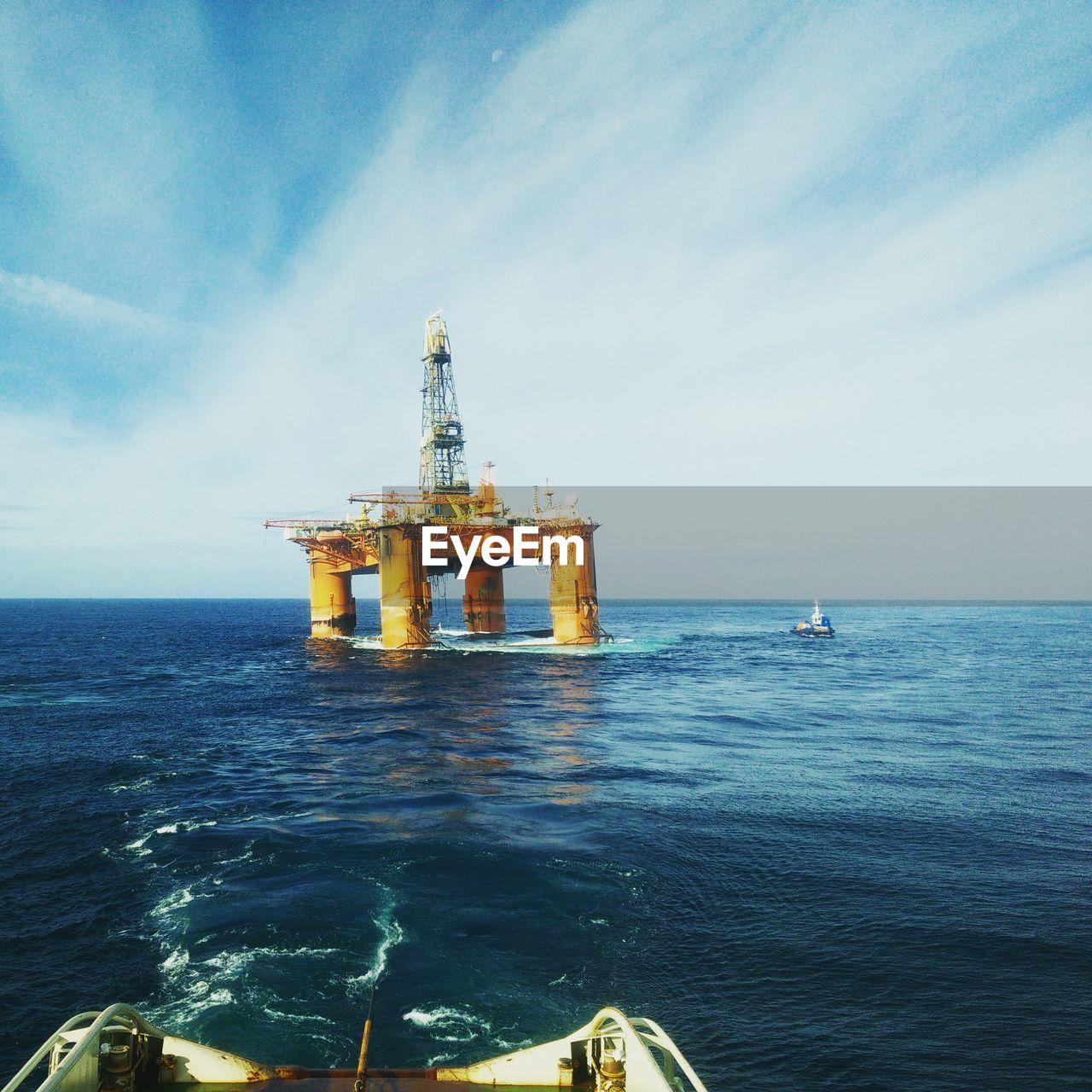 Oil Platform At Sea Against Sky
