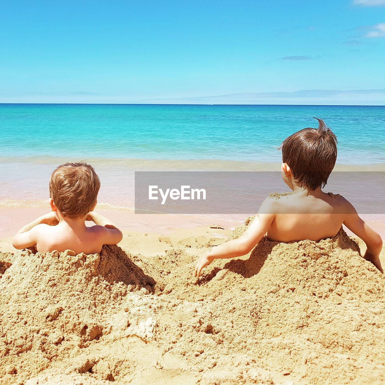 beach, land, sea, water, boys, childhood, child, males, men, two people, sand, real people, sky, shirtless, horizon over water, leisure activity, nature, family, togetherness, innocence, outdoors
