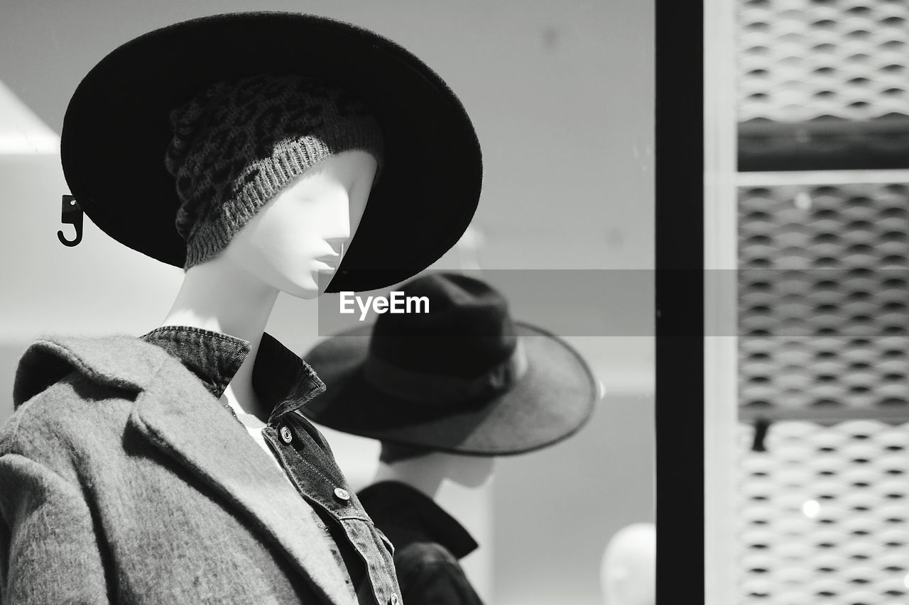 hat, indoors, one person, focus on foreground, music, close-up, headshot, day