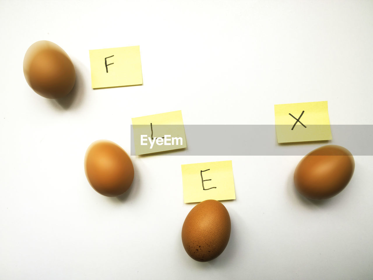 white background, yellow, egg, healthy eating, text, food, no people, indoors, studio shot, communication, brown, close-up, freshness