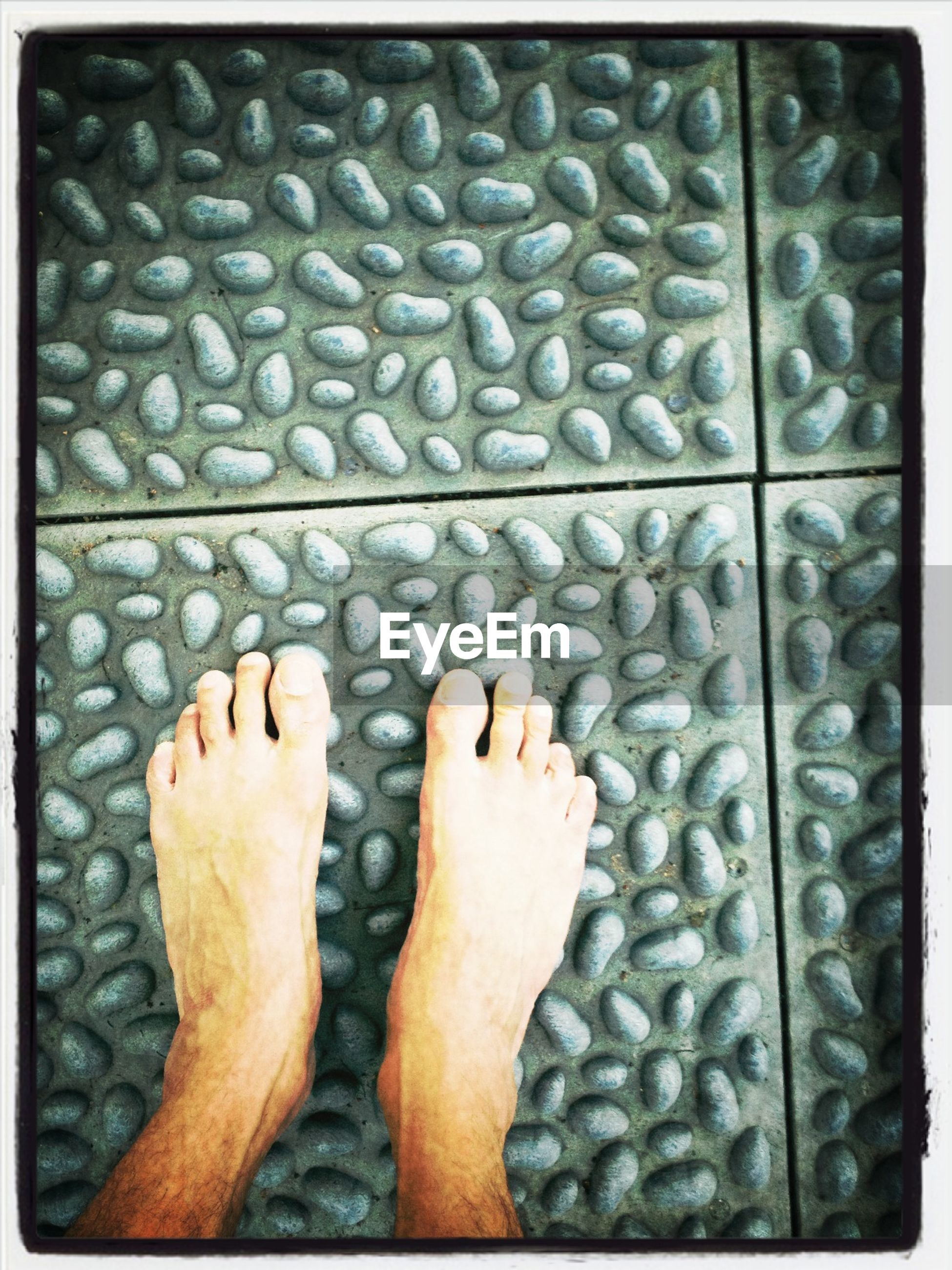Low section of man on textured flooring