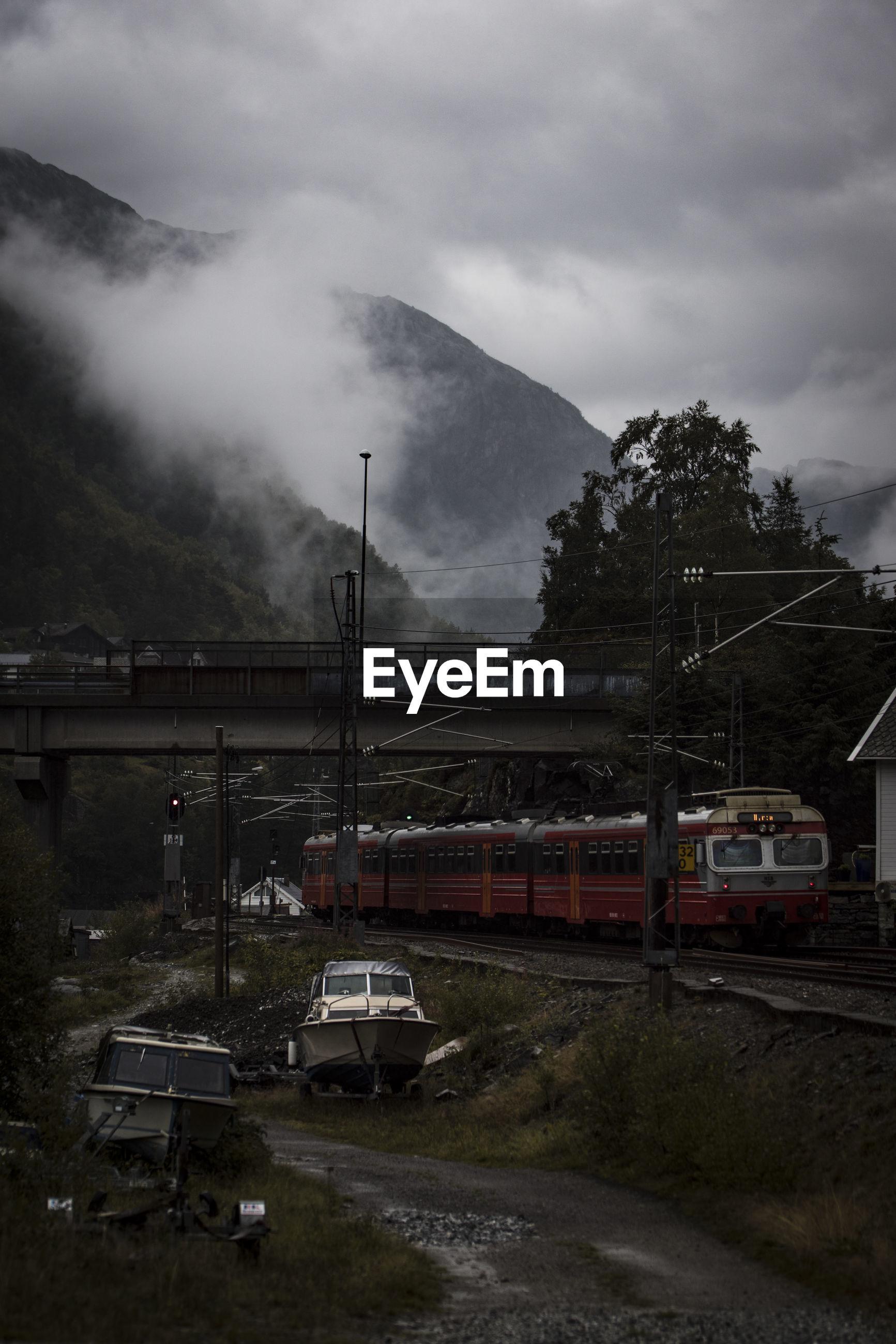 TRAIN AGAINST SKY ON MOUNTAIN