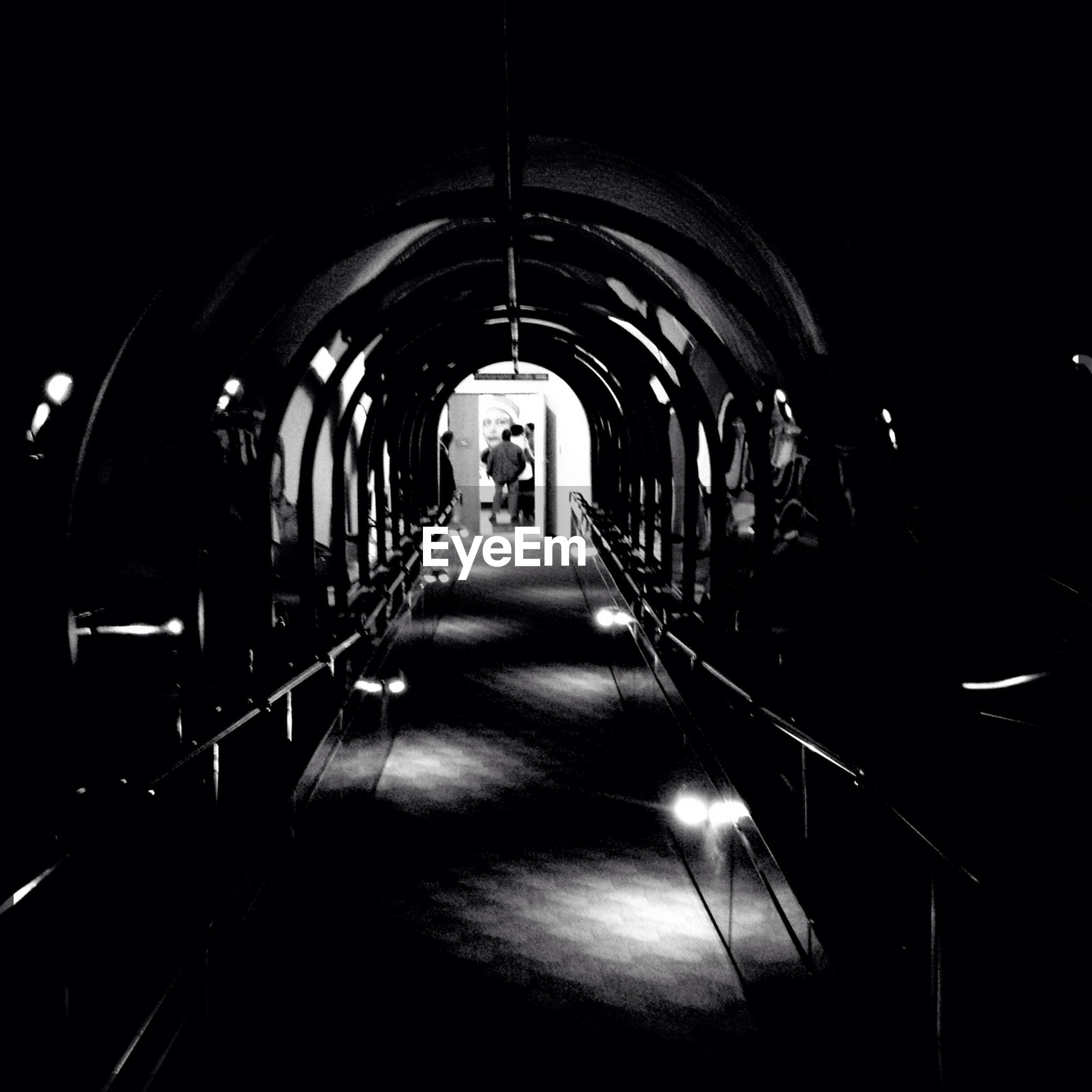 the way forward, indoors, illuminated, tunnel, diminishing perspective, arch, vanishing point, transportation, night, lighting equipment, dark, empty, architecture, built structure, in a row, long, narrow, absence, light at the end of the tunnel, corridor