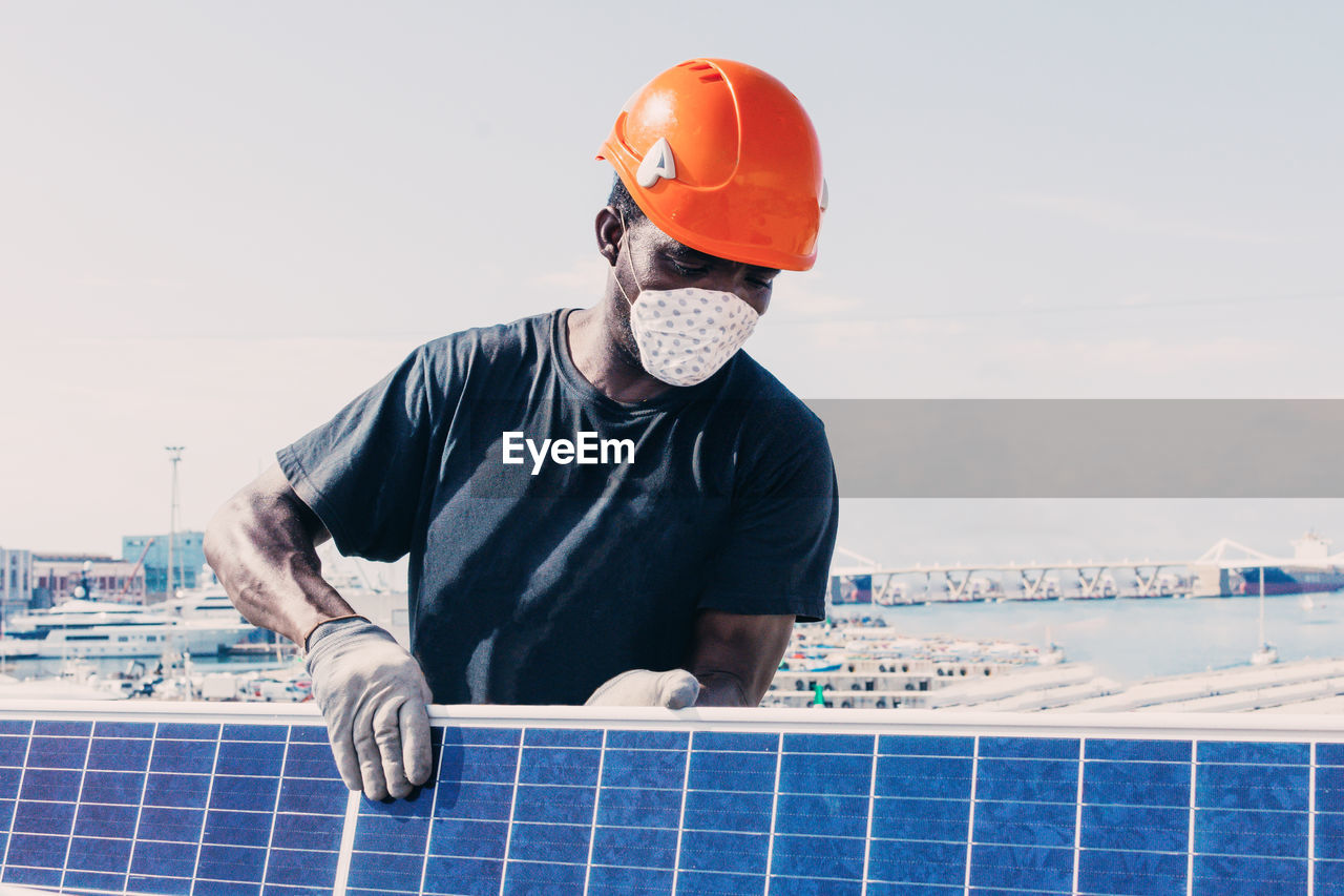 MAN WORKING WITH ARMS RAISED