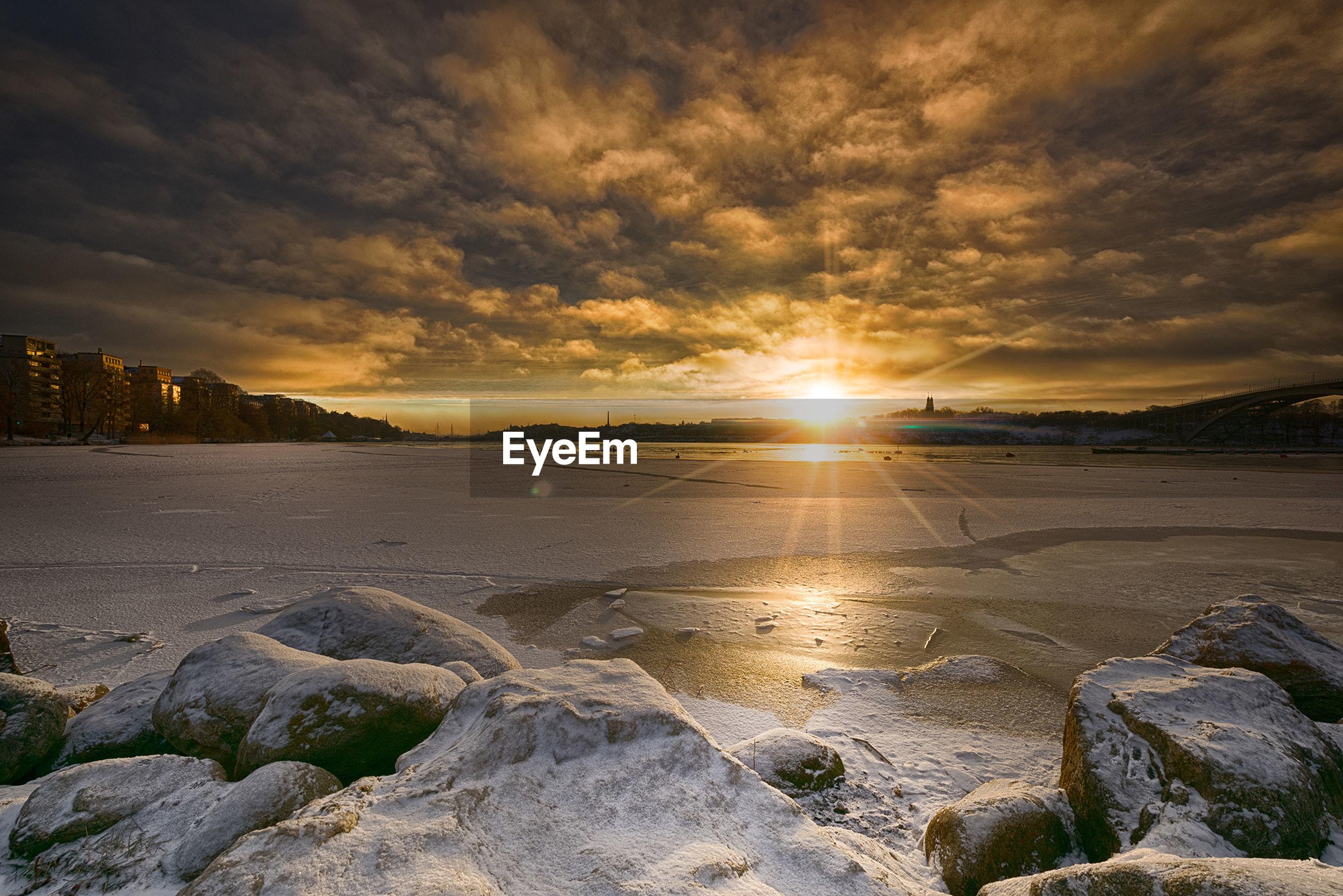 SCENIC VIEW OF BEACH AGAINST ROMANTIC SKY