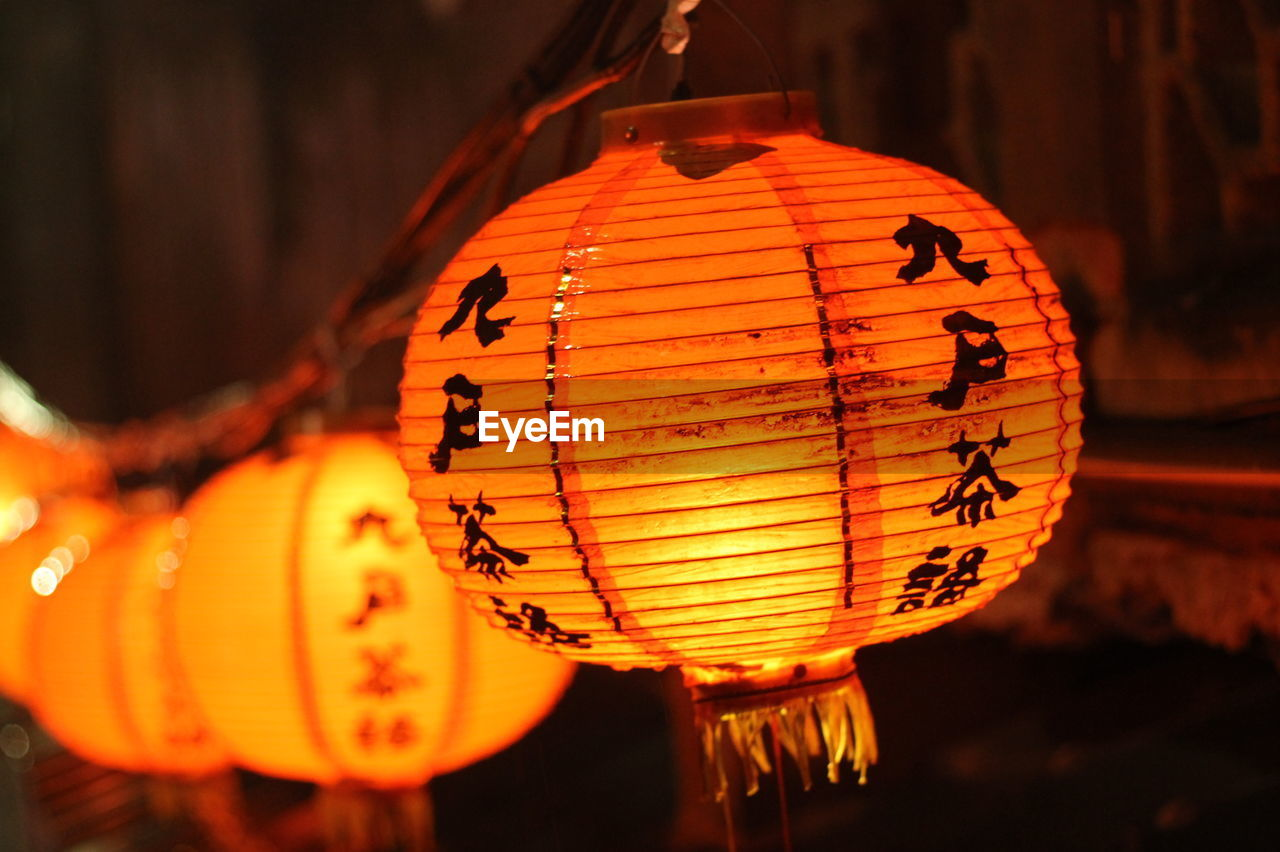 Close-Up Of Illuminated Chinese Lantern Hanging At Night