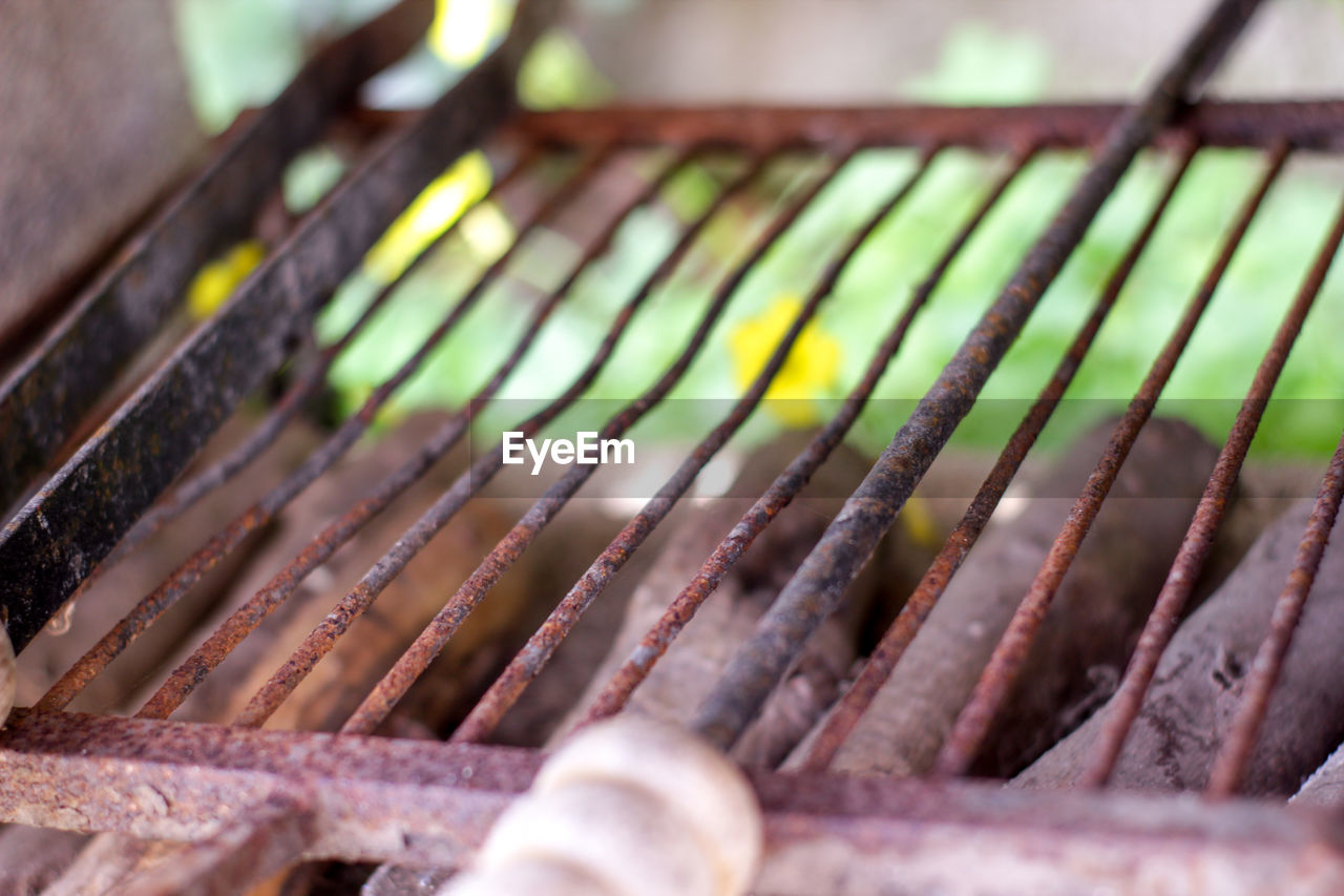 High Angle View Of Rusty Metal Grate