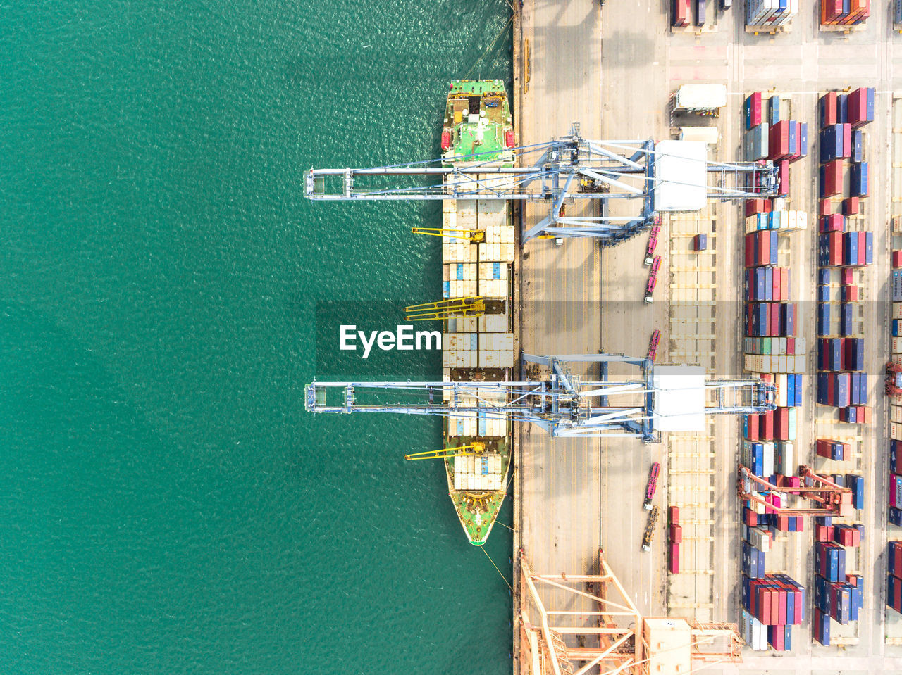 High Angle View Of Cargo Container With Crane By Sea