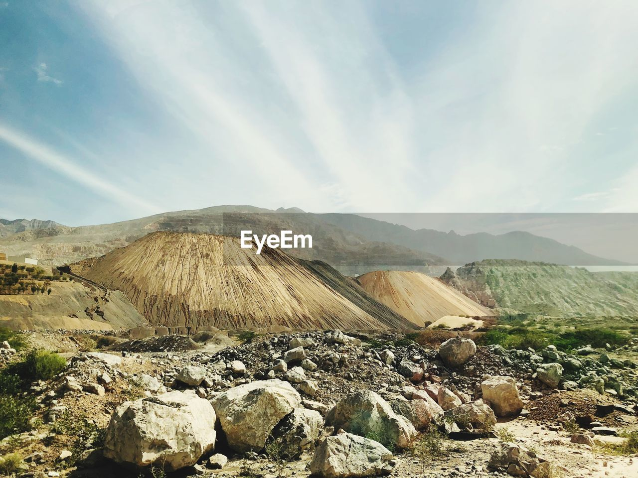 mountain, sky, scenics - nature, beauty in nature, cloud - sky, environment, landscape, nature, tranquil scene, day, no people, non-urban scene, tranquility, land, volcano, idyllic, solid, rock, mountain range, remote, outdoors, mountain peak, volcanic crater, formation