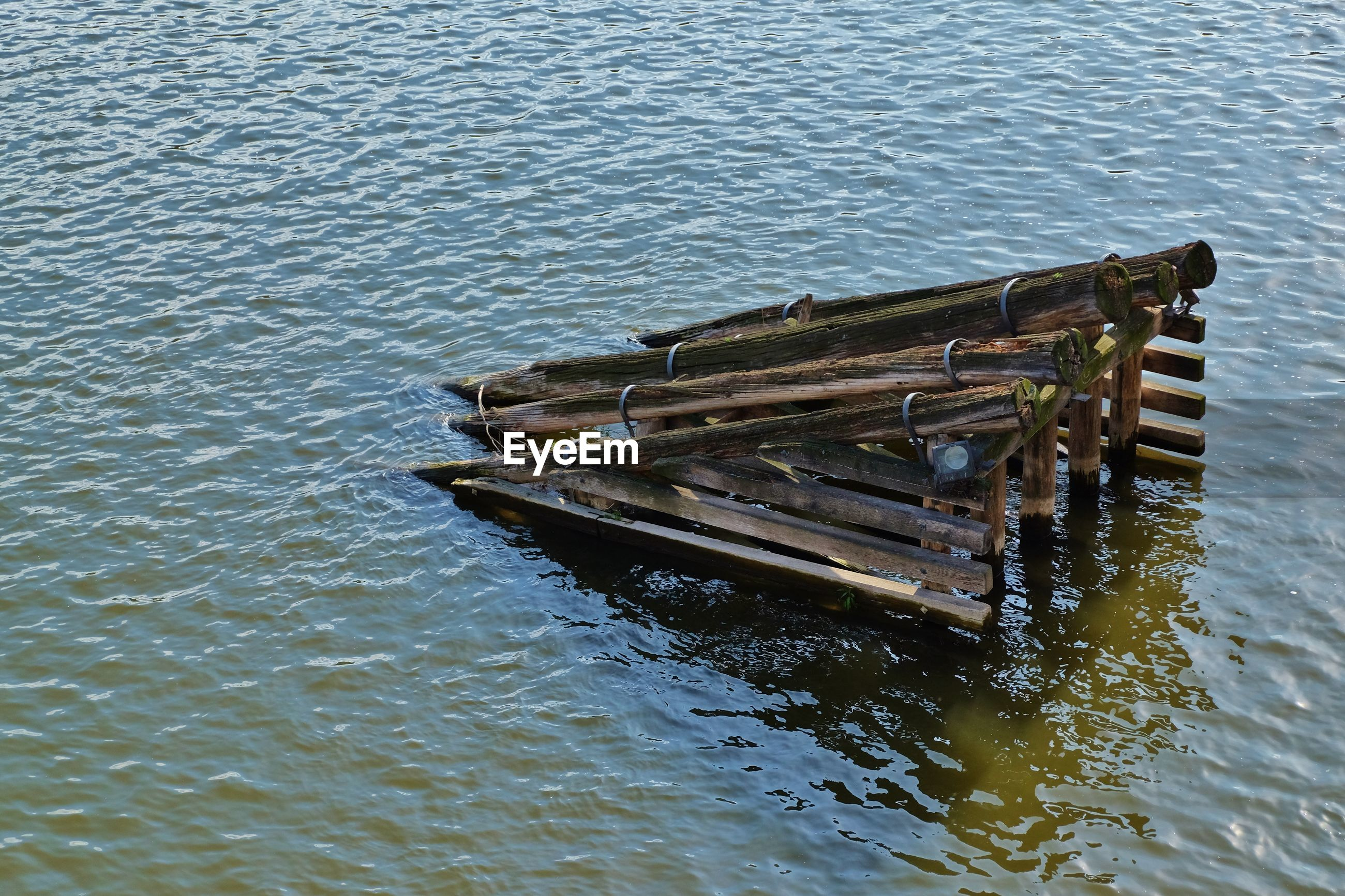 Damaged pier in water