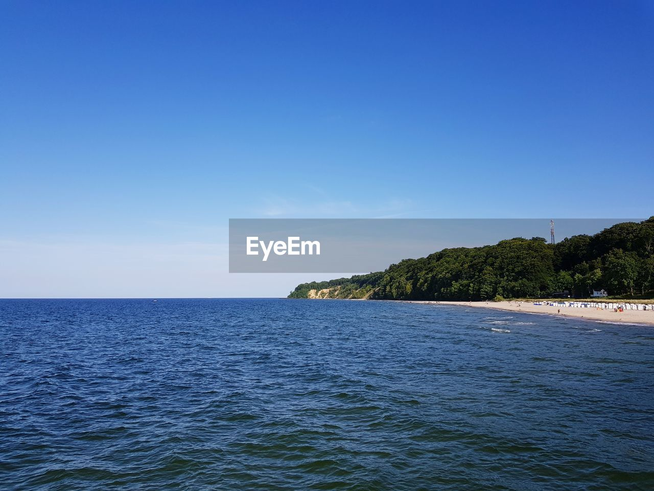 sky, water, sea, scenics - nature, beauty in nature, waterfront, tranquil scene, copy space, tranquility, blue, horizon, nature, horizon over water, clear sky, idyllic, no people, non-urban scene, land, day, outdoors