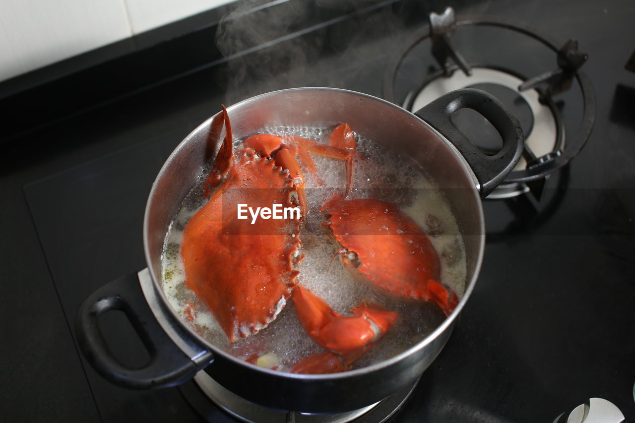 food and drink, food, indoors, household equipment, close-up, freshness, kitchen utensil, healthy eating, wellbeing, no people, high angle view, stove, appliance, still life, preparation, preparing food, domestic room, vegetable, kitchen, red, cooking utensil