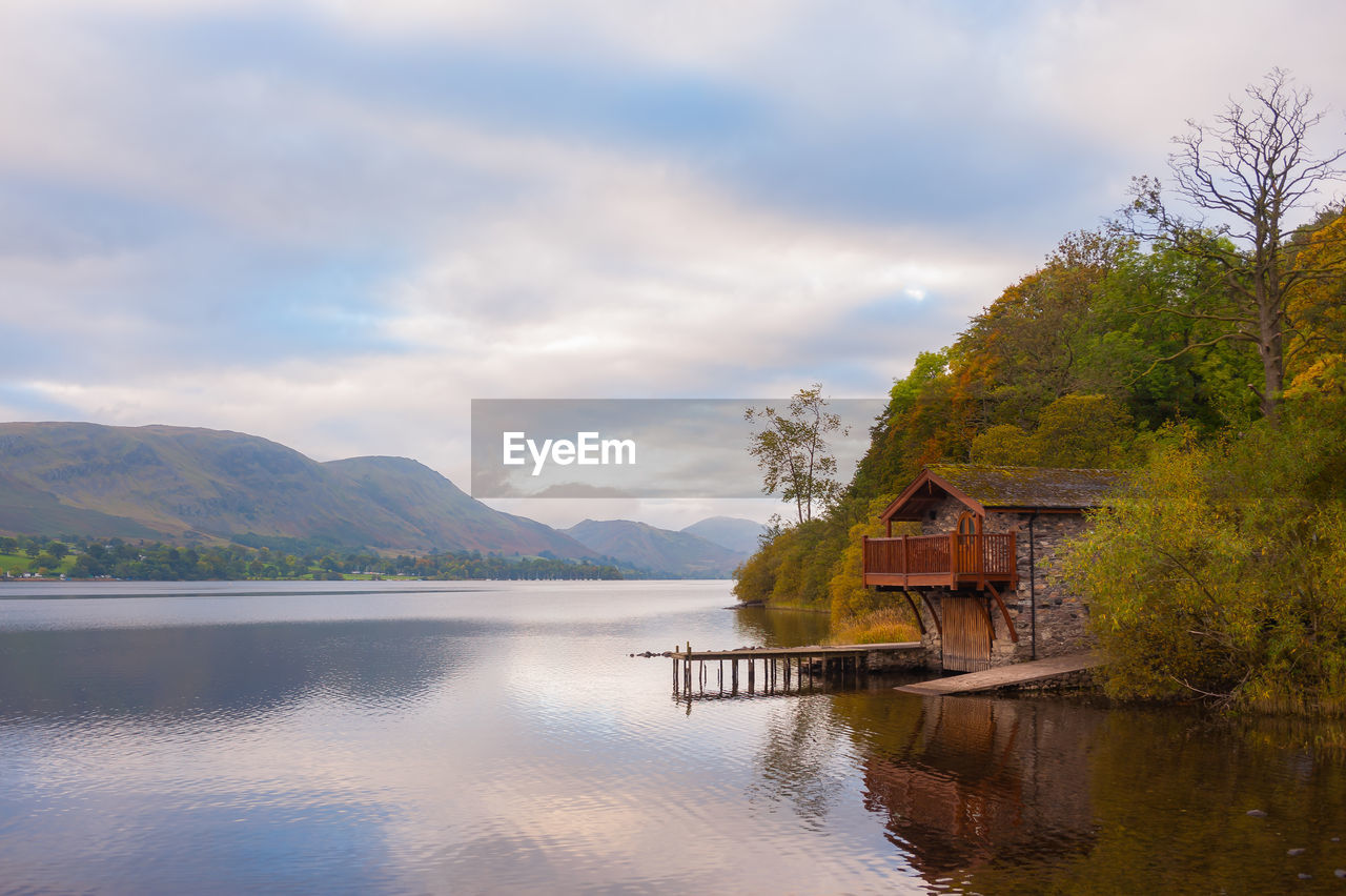 water, mountain, tree, beauty in nature, cloud - sky, architecture, plant, scenics - nature, sky, built structure, lake, house, building, tranquility, nature, waterfront, building exterior, tranquil scene, no people, outdoors, cottage