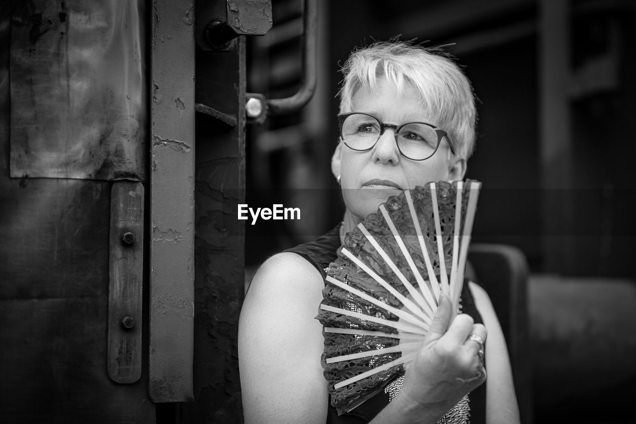 Mature Woman Holding Paper Fan