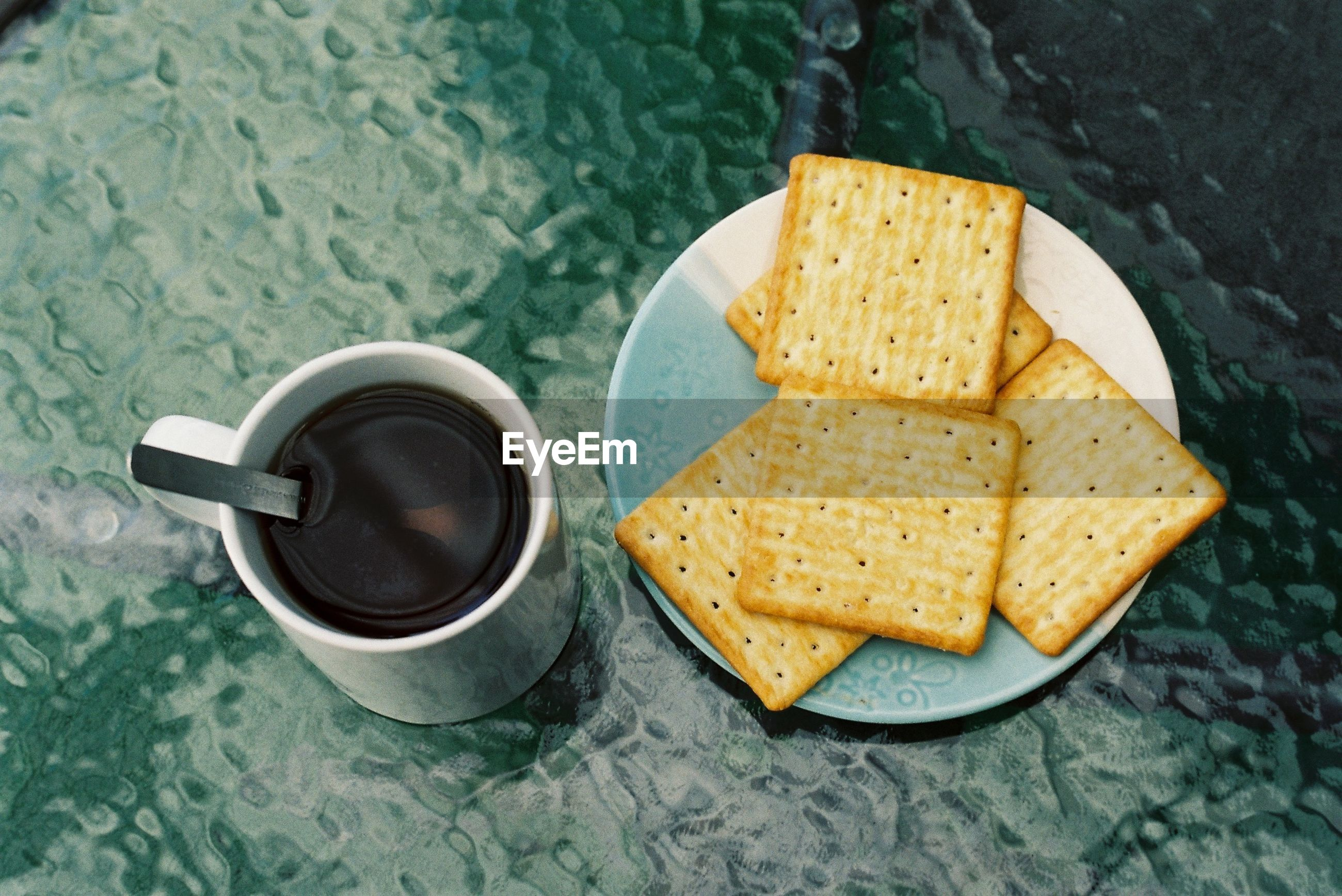 HIGH ANGLE VIEW OF BREAKFAST WITH COFFEE CUP