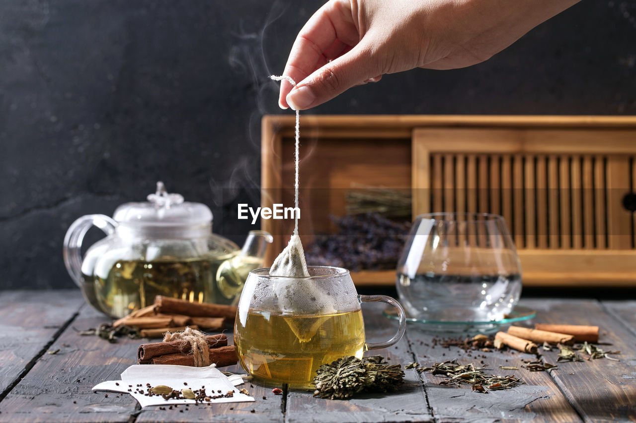 Cropped Image Of Woman Preparing Herbal Tea On Table
