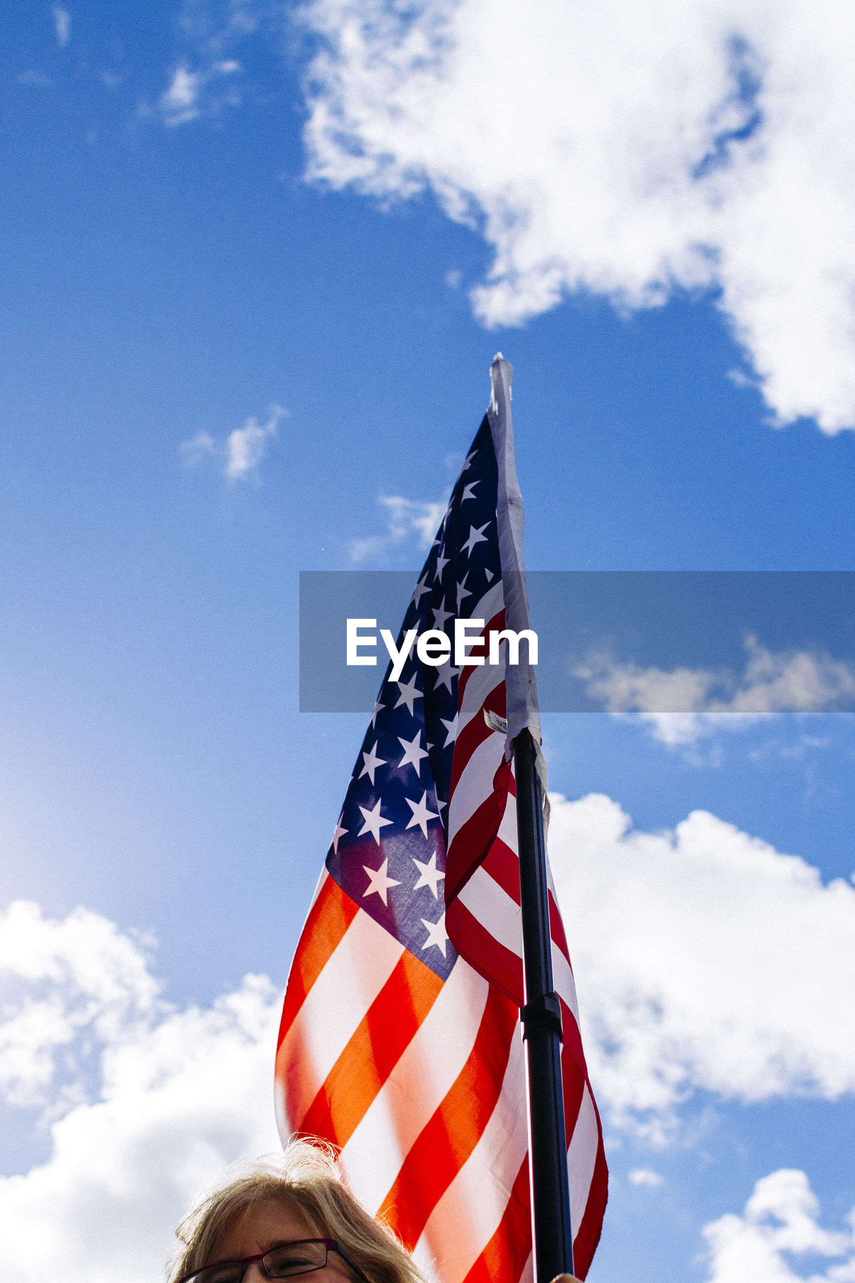 sky, flag, patriotism, cloud - sky, low angle view, stars and stripes, striped, day, no people, outdoors