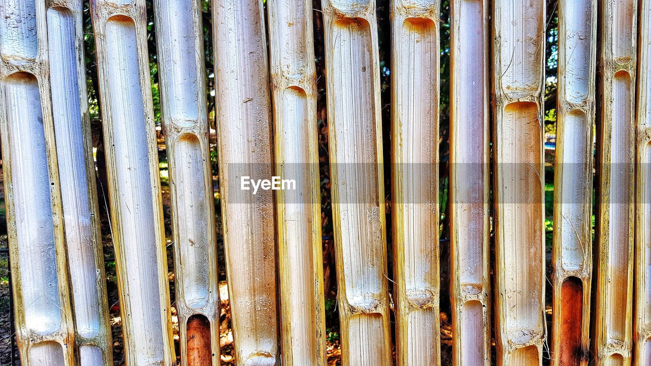 backgrounds, full frame, no people, bamboo, day, close-up, pattern, side by side, bamboo - plant, large group of objects, bamboo - material, metal, outdoors, detail, wood - material, weathered, textured, nature, repetition, pipe - tube, silver colored