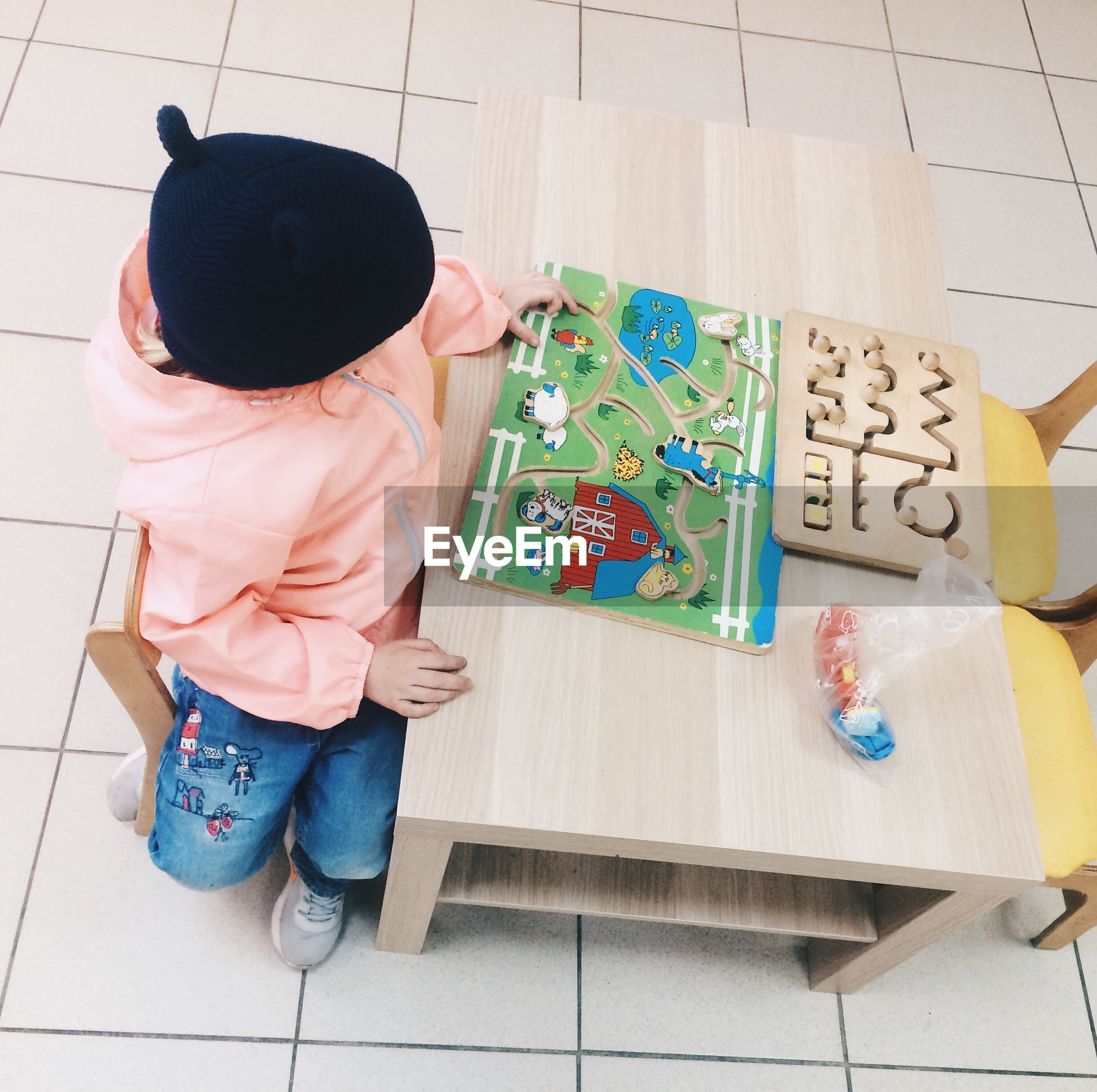 High angle view of boy playing with board game