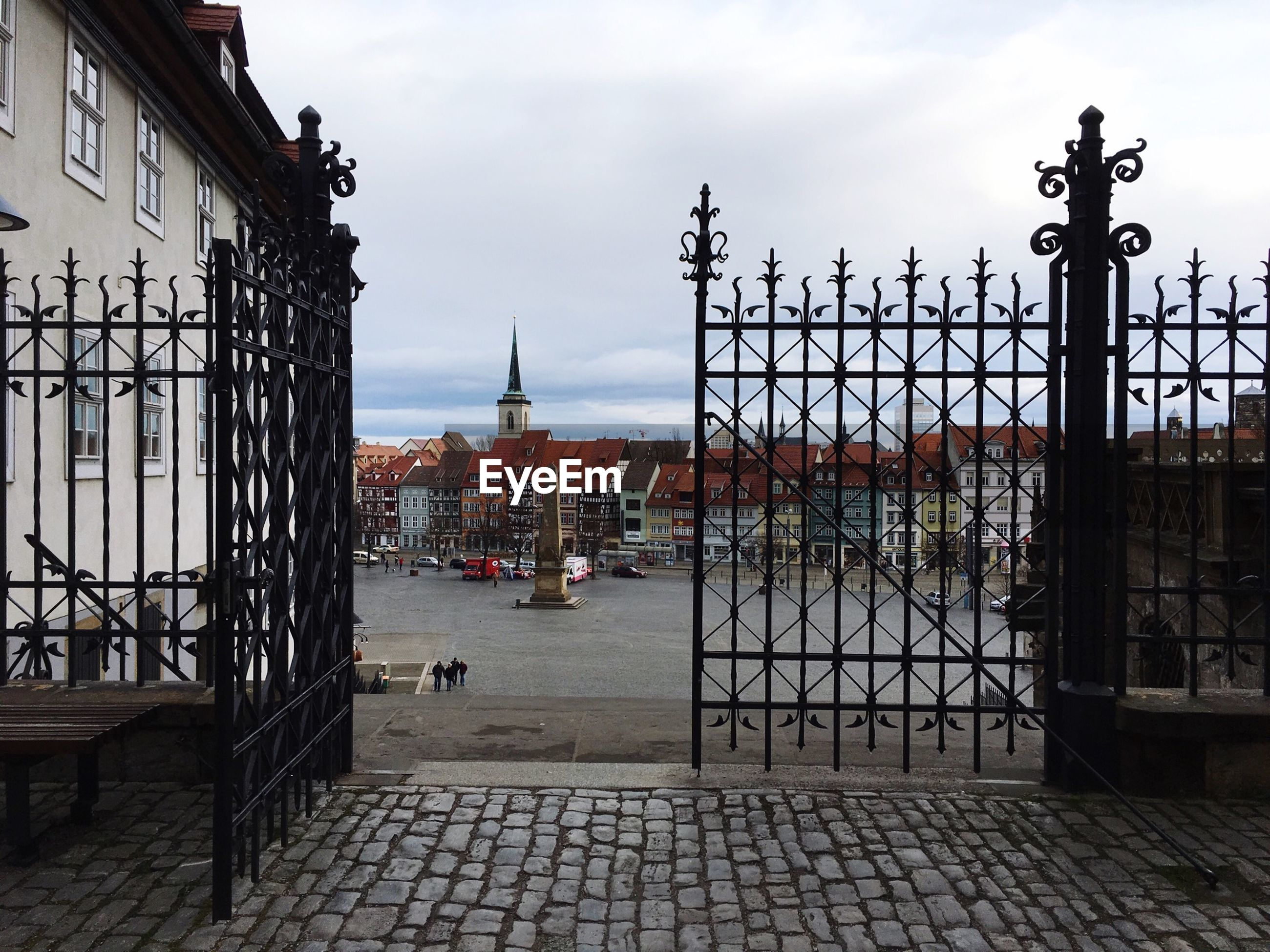 Gate at town square against sky