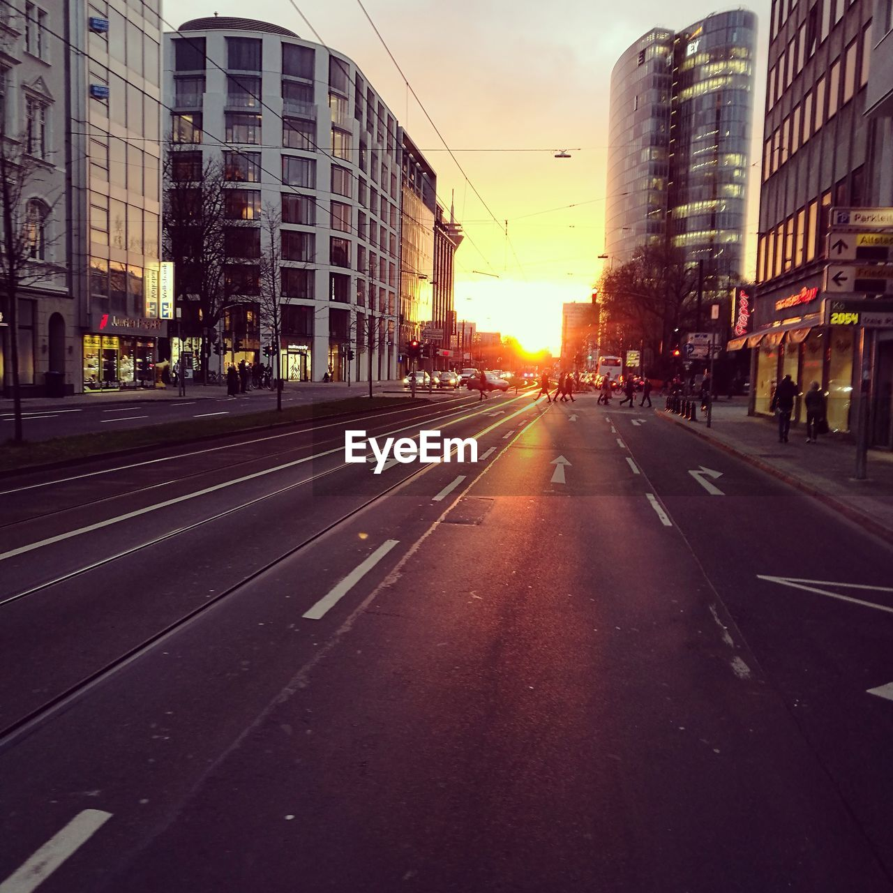 architecture, city, building exterior, road, street, built structure, outdoors, sunset, no people, modern, sky, day