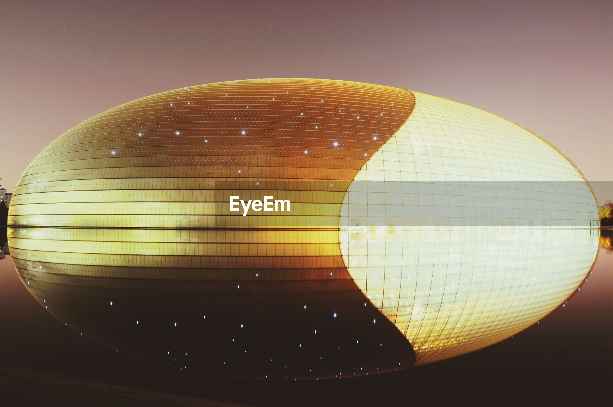 sphere, circle, illuminated, indoors, close-up, pattern, low angle view, lighting equipment, geometric shape, shape, decoration, glass - material, no people, hanging, copy space, transparent, clear sky, sky, reflection, single object