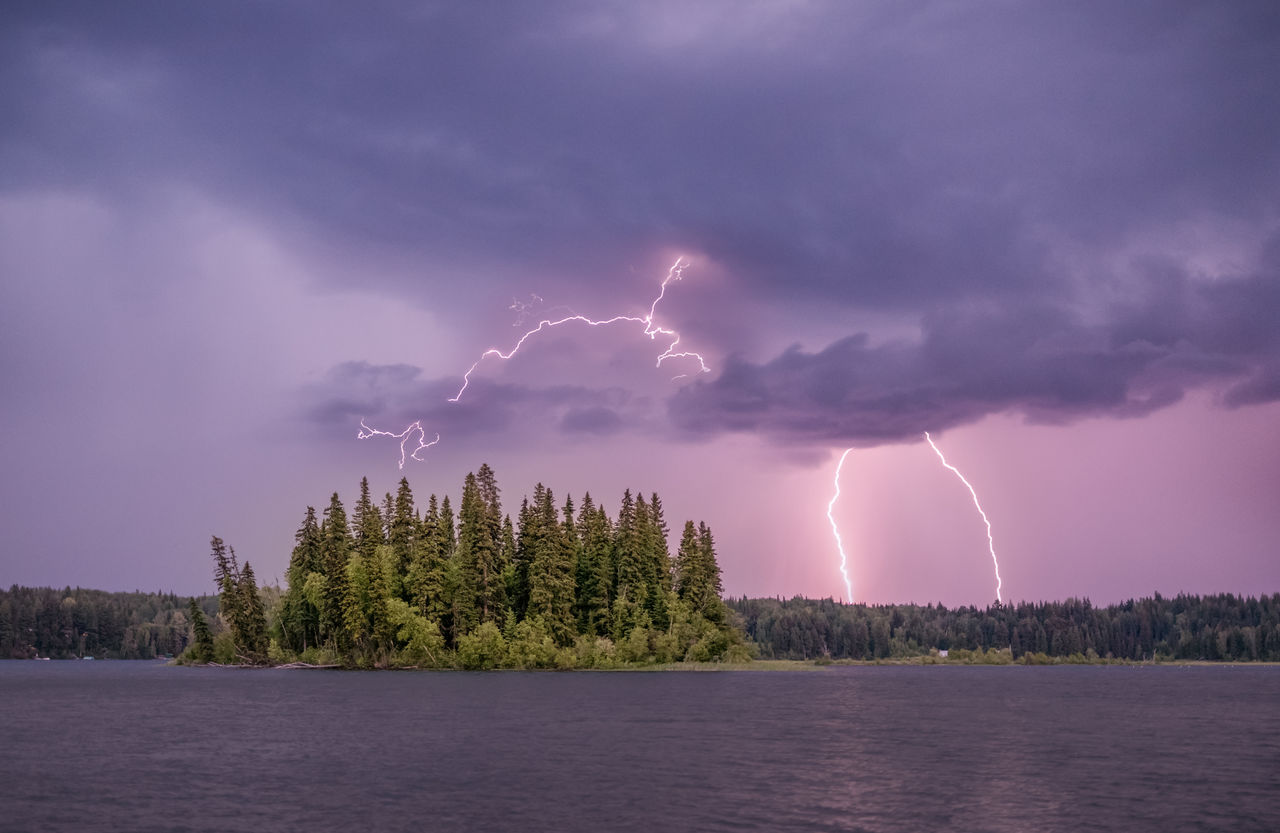 Panoramic View Of Lightning Over Lake Against Sky