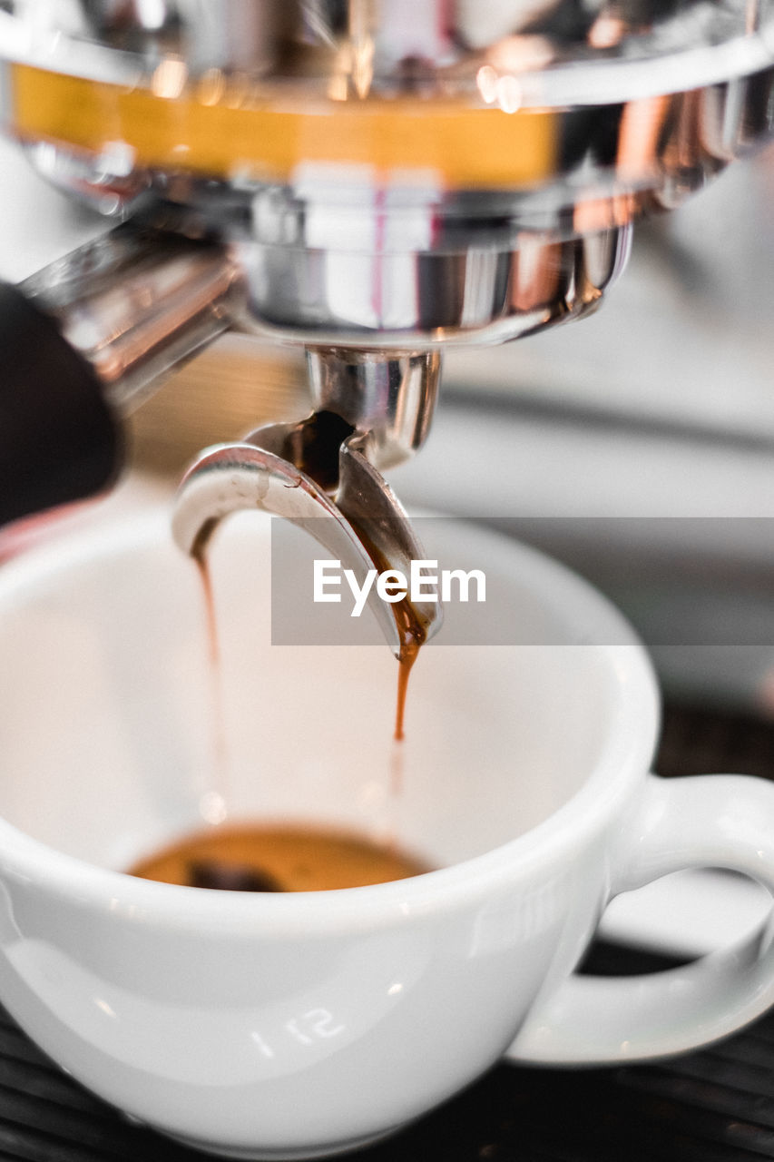cup, coffee, mug, drink, coffee - drink, food and drink, coffee cup, refreshment, coffee maker, pouring, machinery, freshness, indoors, cafe, appliance, espresso maker, close-up, espresso, motion, hot drink, no people, coffee shop, preparation, crockery, caffeine