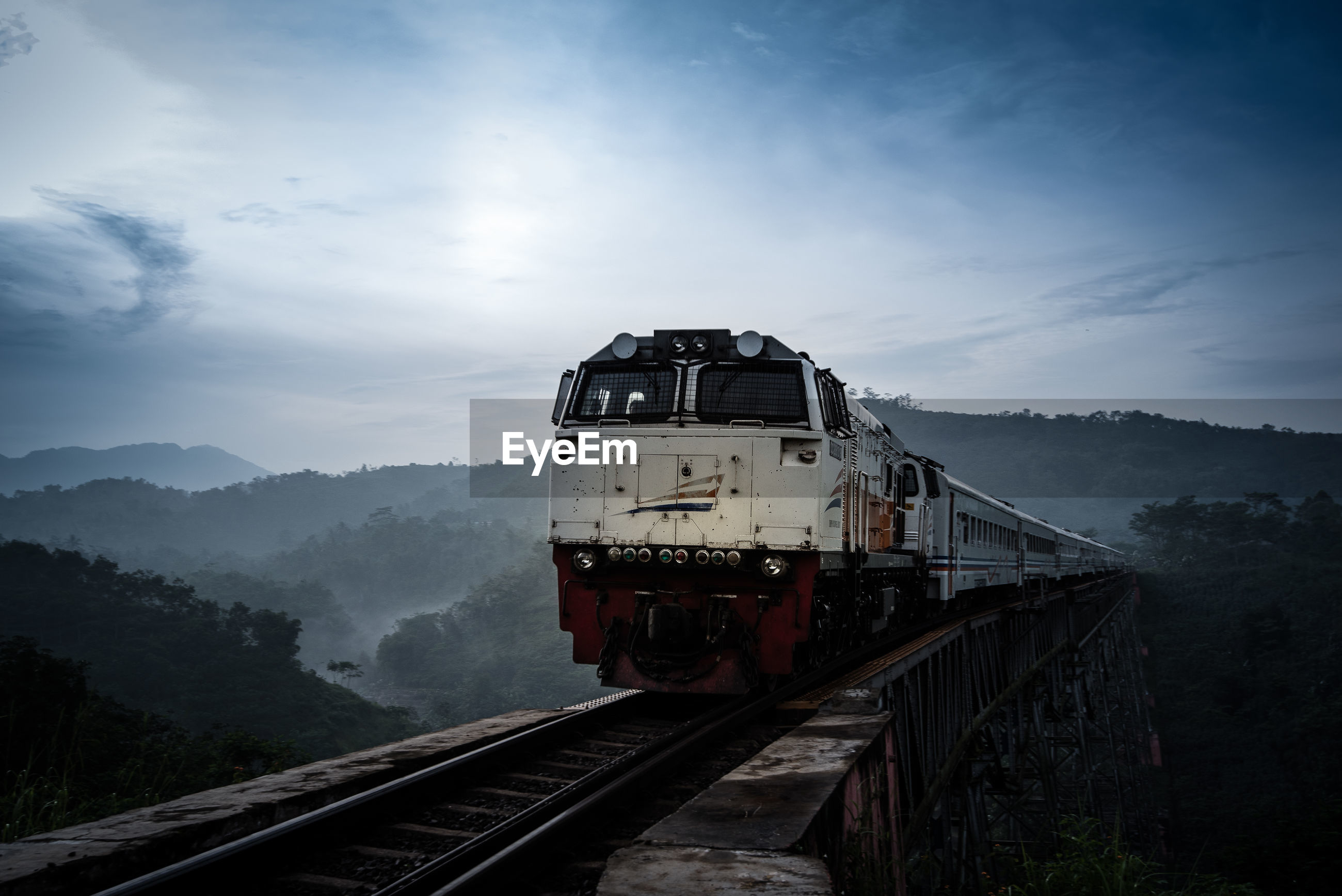 Train on railroad track against sky