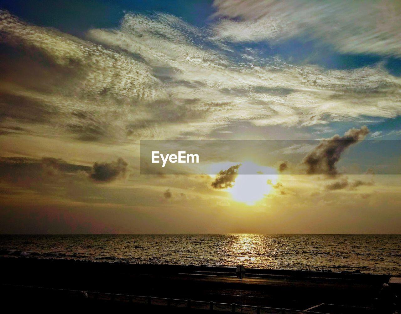 sky, cloud - sky, sea, horizon, horizon over water, sunset, scenics - nature, water, beauty in nature, tranquility, tranquil scene, nature, idyllic, no people, sunlight, dramatic sky, outdoors, land, beach