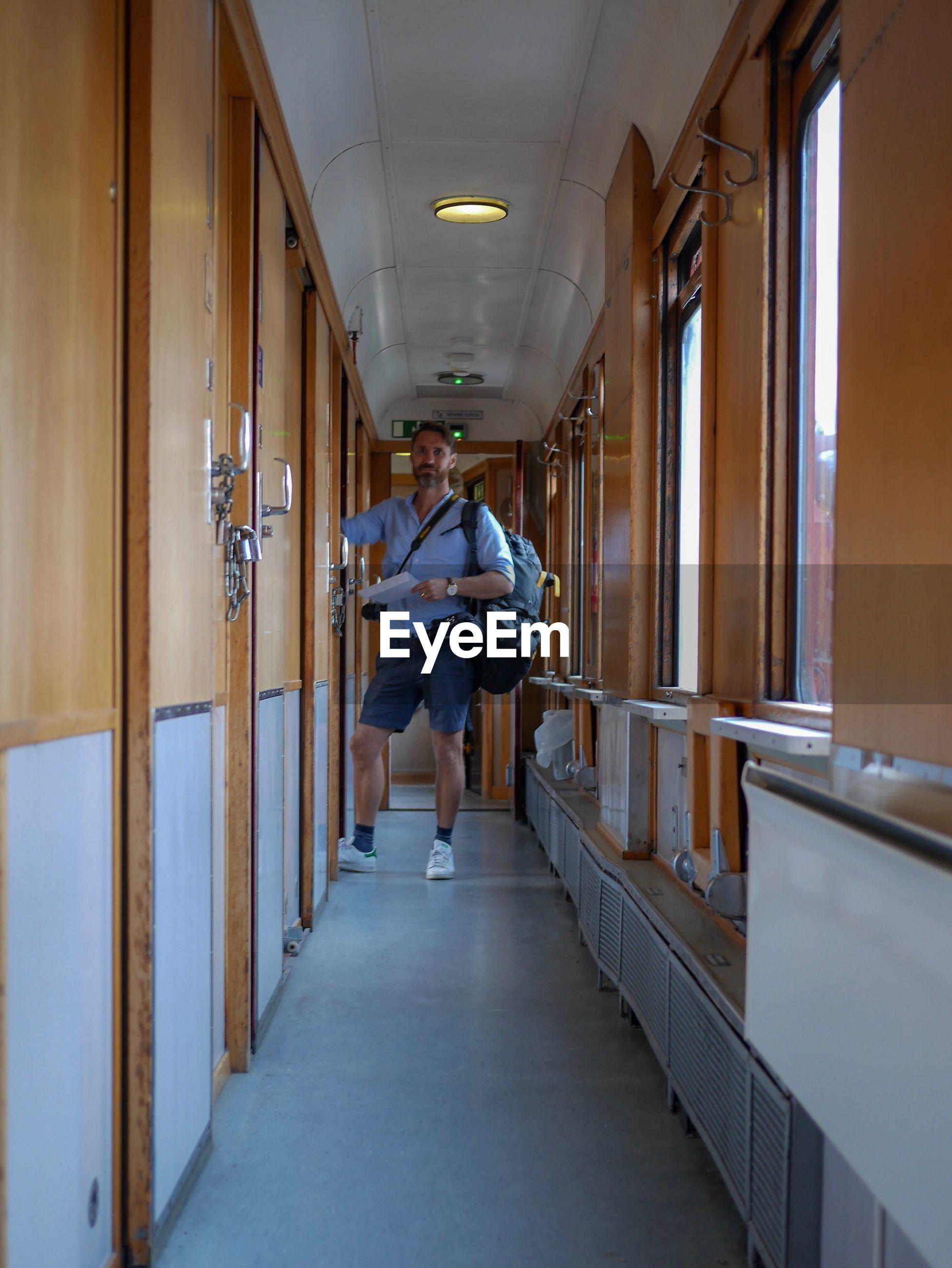 Portrait of man standing in corridor of building