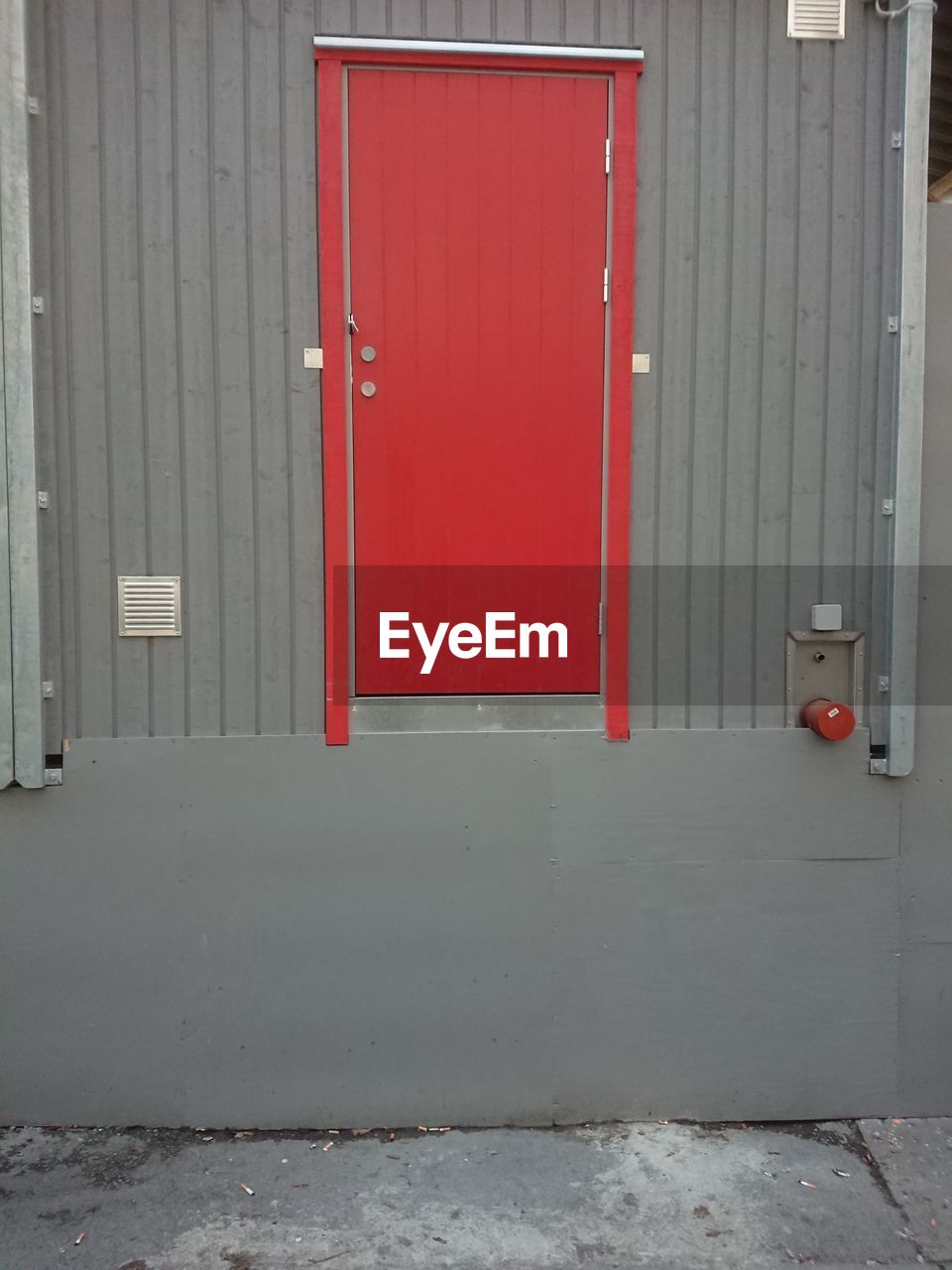 door, entrance, architecture, red, safety, security, built structure, protection, building exterior, closed, building, no people, day, wall - building feature, outdoors, wood - material, city, metal, gray, communication, garage