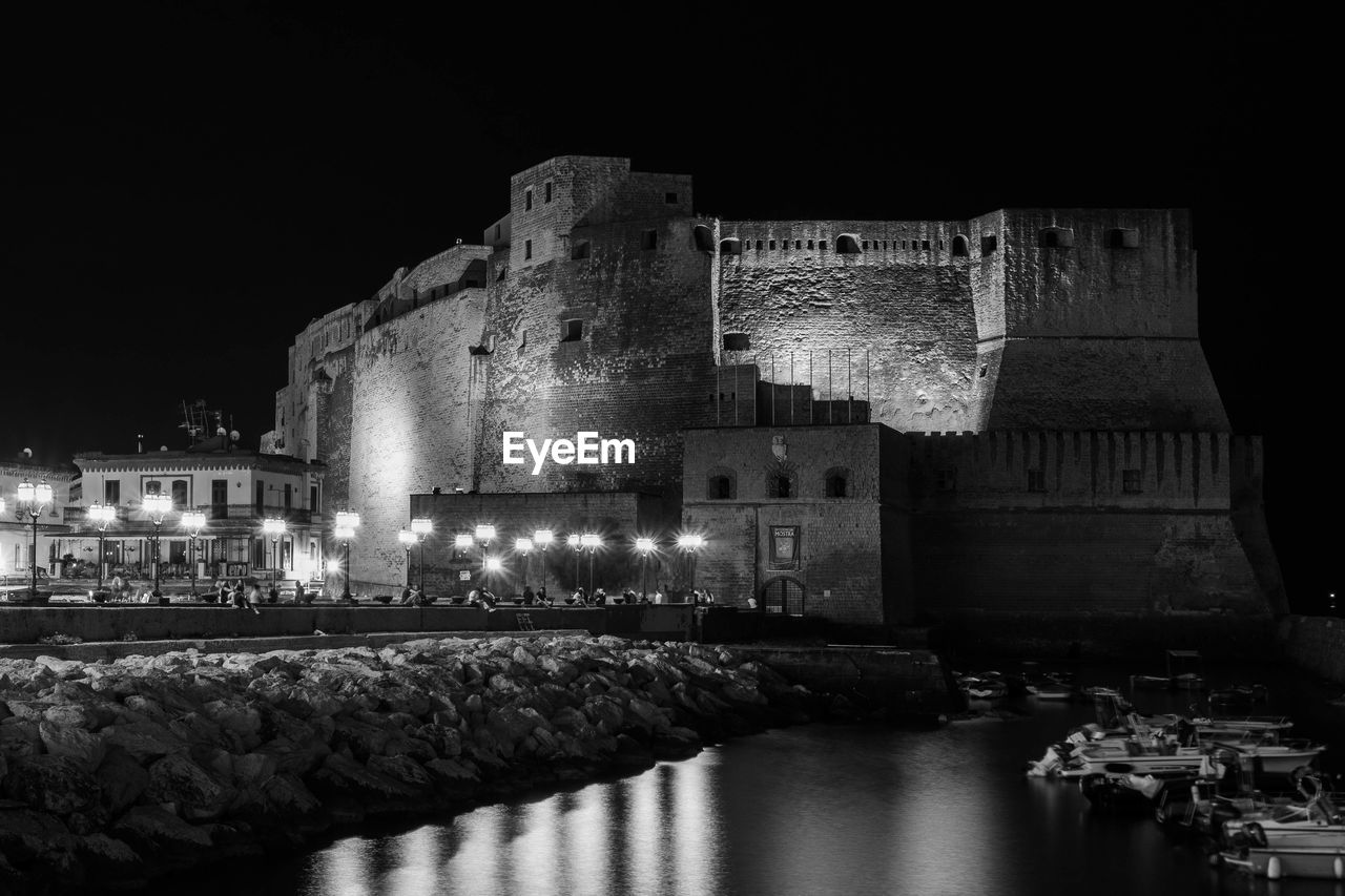 architecture, built structure, building exterior, water, night, building, illuminated, history, the past, nature, travel destinations, castle, waterfront, no people, reflection, sky, tourism, ancient, fort, ancient civilization