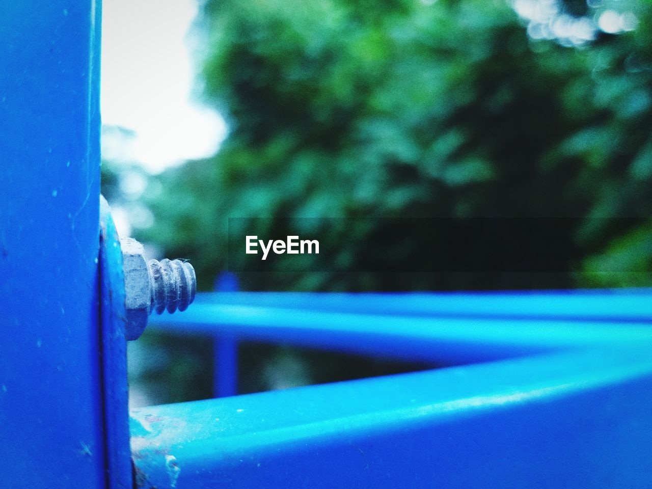 blue, focus on foreground, close-up, day, no people, metal, outdoors, selective focus, safety, protection, nature, railing, security, plant, window, tree, single object, architecture, detail, wood - material