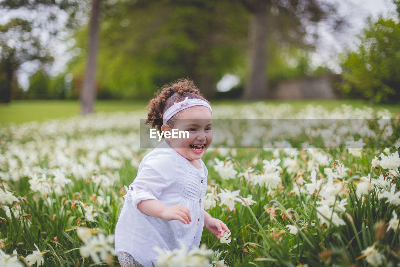 Portrait Of Happy Girl In A Meadow