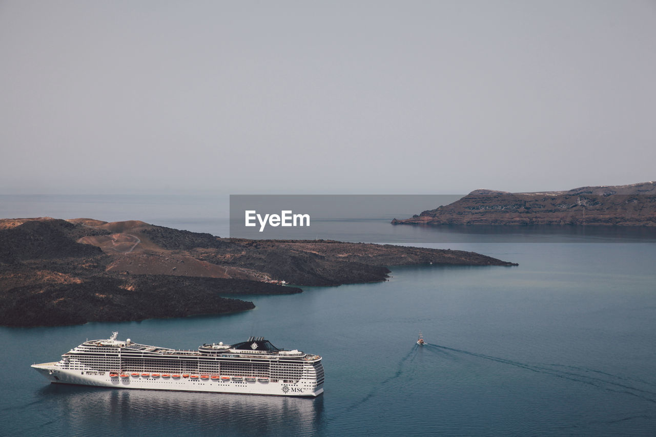 High Angle View Of Cruise Ship In Sea Against Clear Sky On Sunny Day