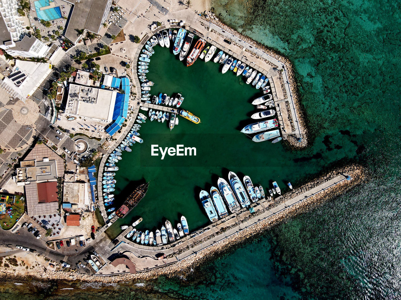 Aerial view of boat moored at sea by town