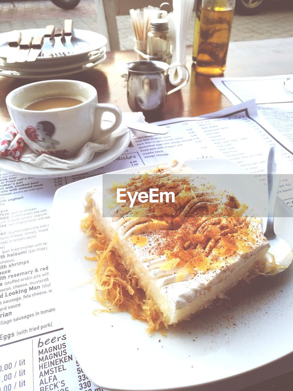 food and drink, table, coffee cup, plate, indoors, food, refreshment, serving size, freshness, sweet food, coffee - drink, drink, breakfast, saucer, indulgence, no people, ready-to-eat, close-up, day, newspaper