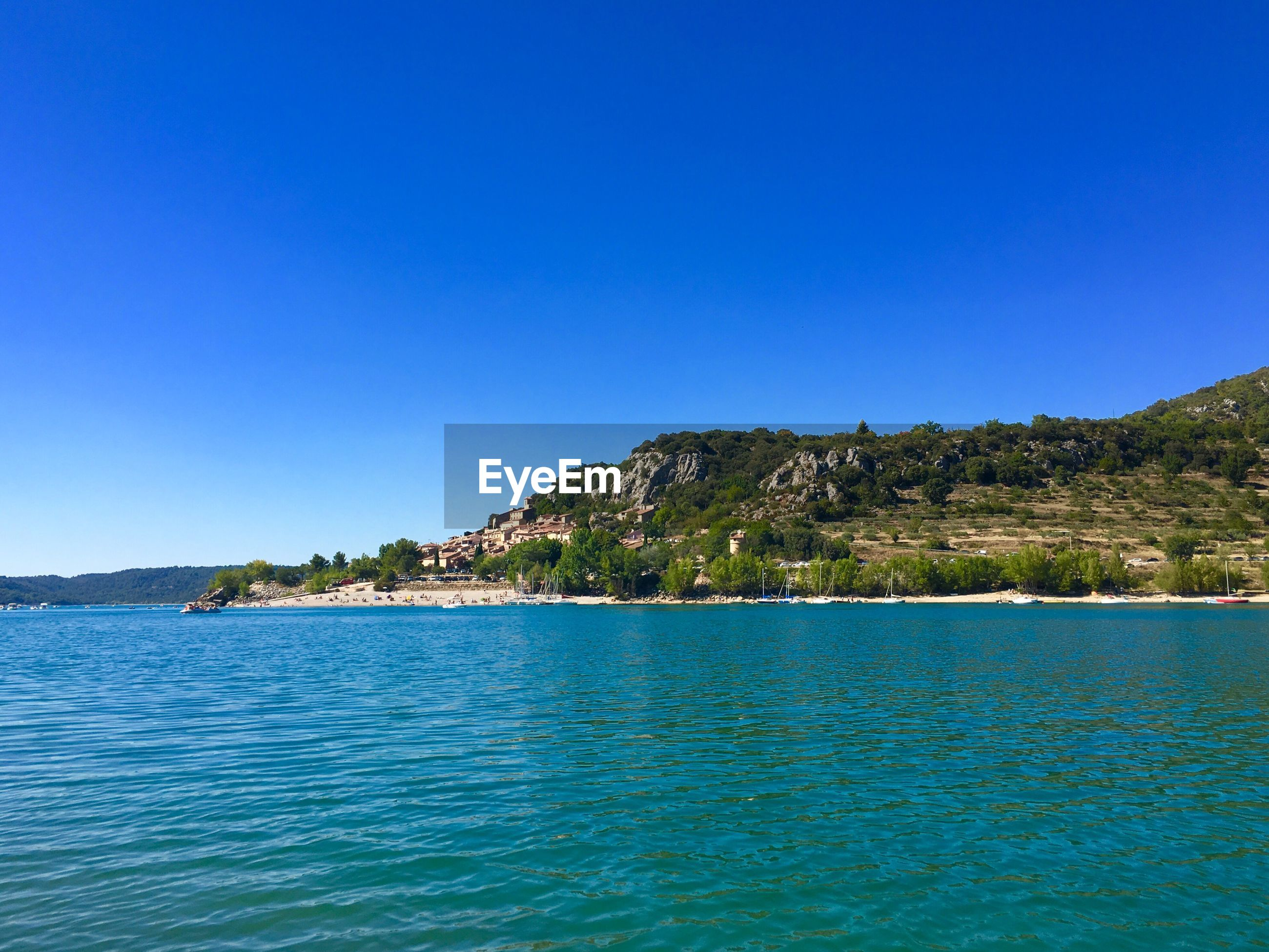 blue, clear sky, mountain, sea, nature, tranquil scene, copy space, water, beauty in nature, waterfront, scenics, tranquility, no people, outdoors, day, view into land, sky