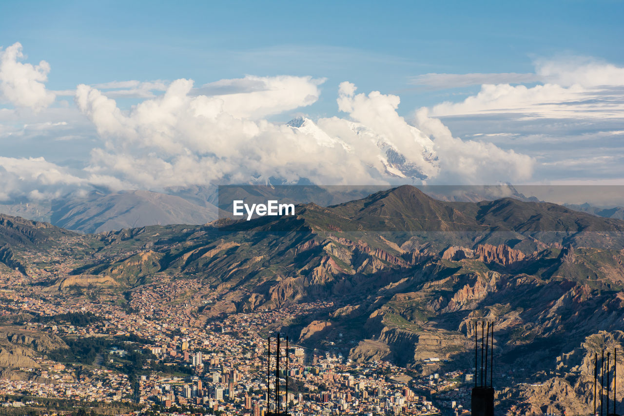 Aerial View Of Cityscape With Mountains In Background