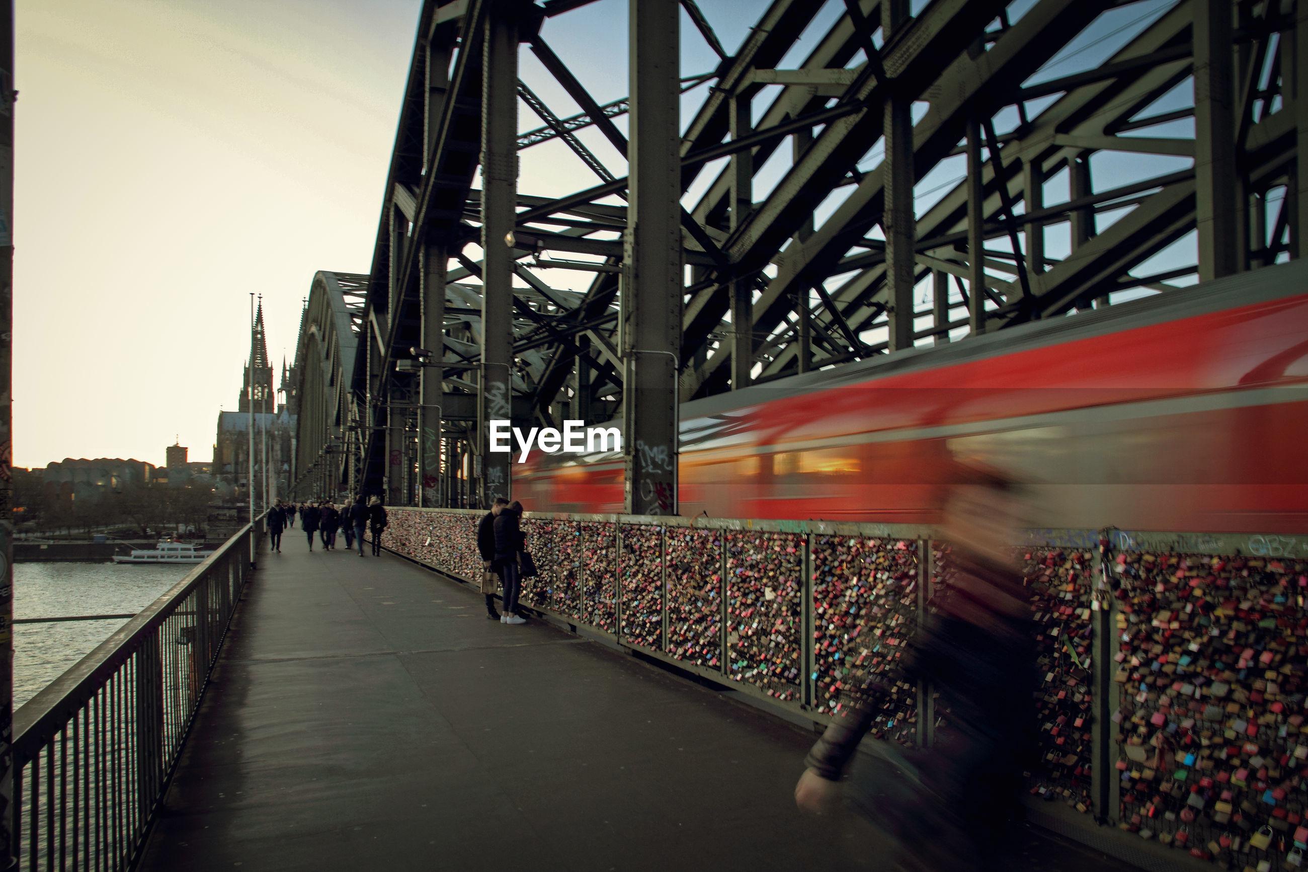People walking on bridge in germany