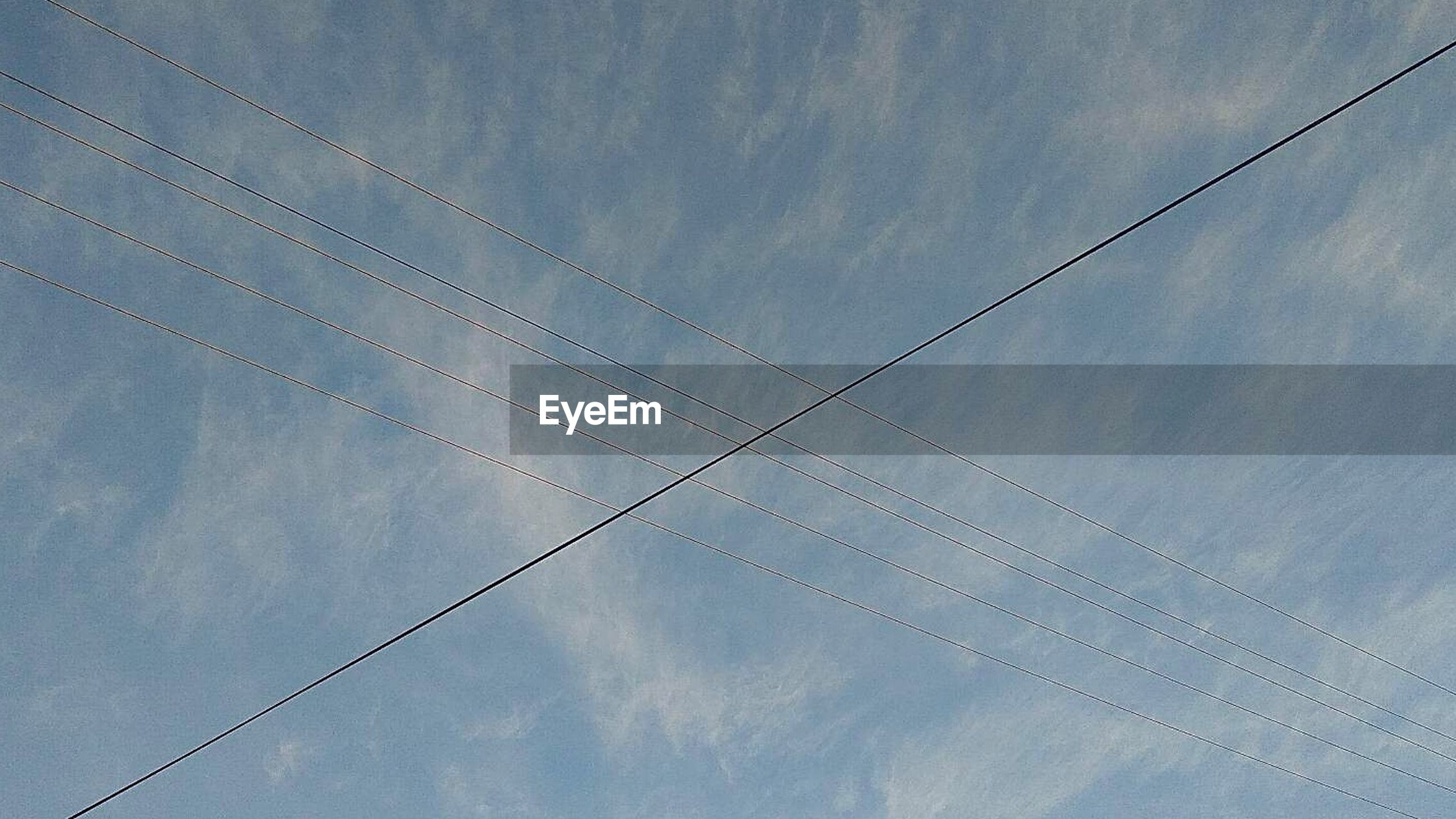 cable, low angle view, power line, sky, power supply, no people, connection, electricity, day, cloud - sky, vapor trail, nature, outdoors, telephone line, beauty in nature, technology, contrail