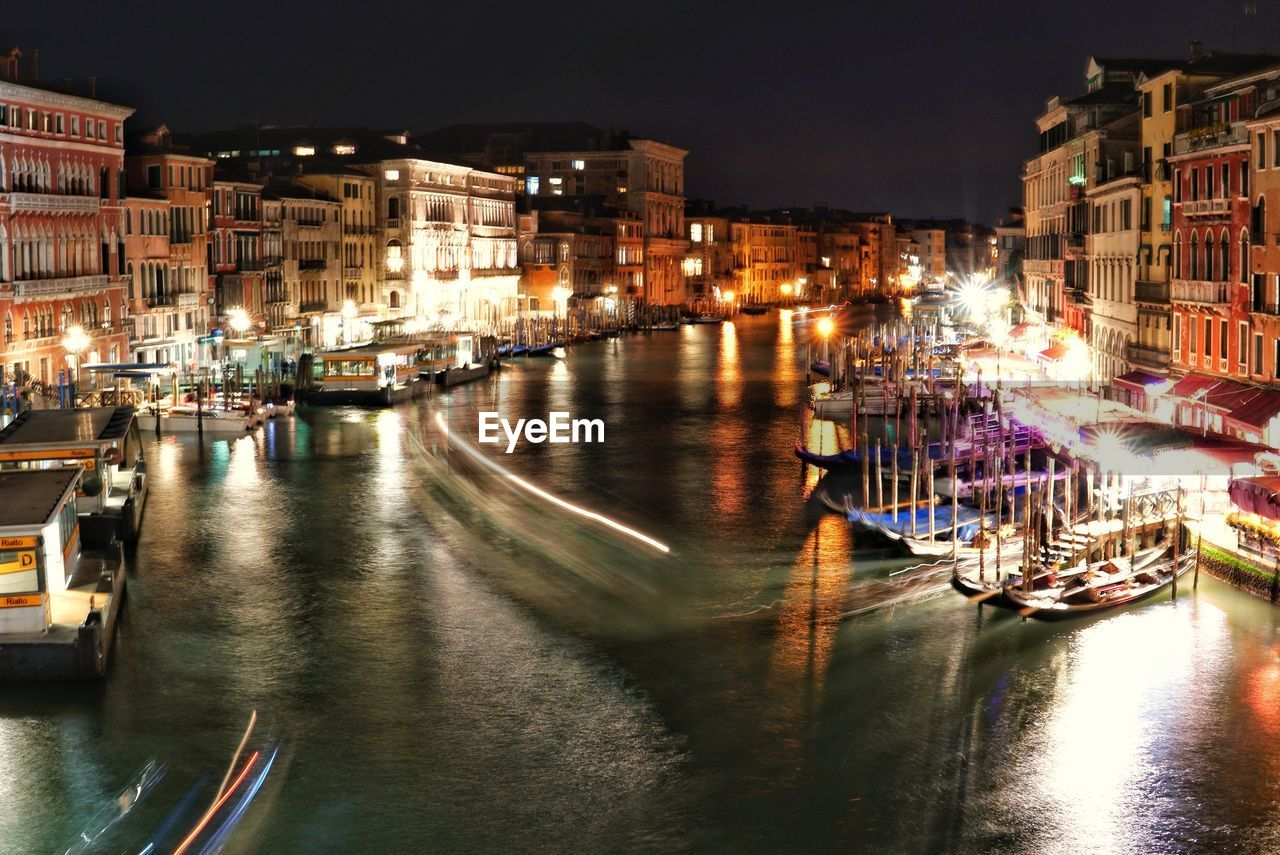 nautical vessel, transportation, illuminated, water, mode of transportation, architecture, night, building exterior, built structure, city, waterfront, reflection, canal, nature, moored, no people, building, light, nightlife