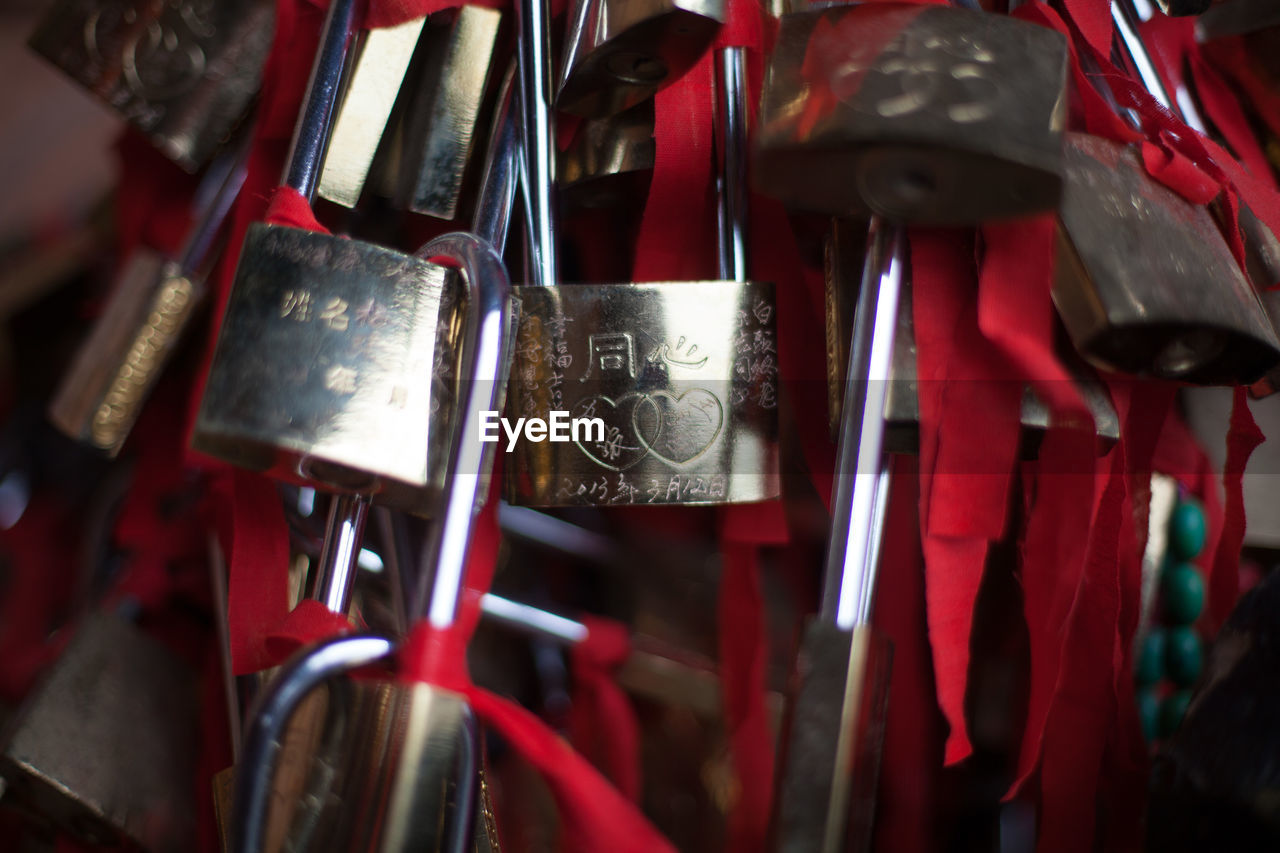 Close-up of religious padlocks in temple