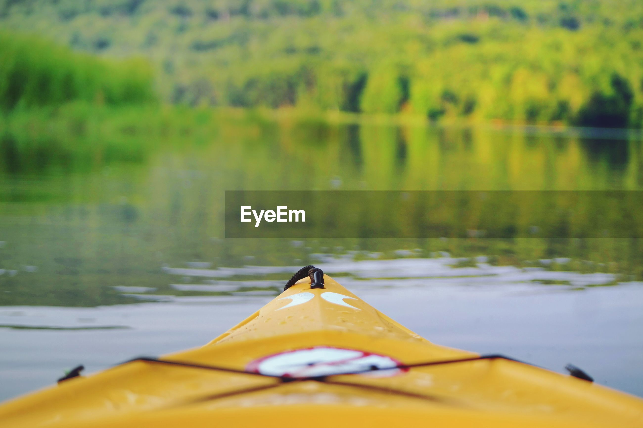 Close-up of yellow kayak on river