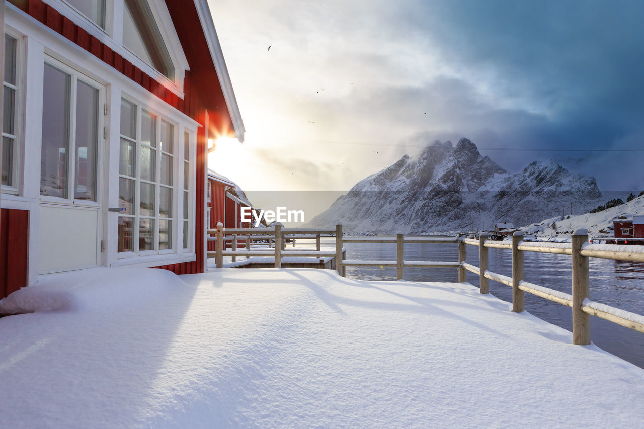 snow, winter, cold temperature, nature, weather, sky, mountain, beauty in nature, frozen, no people, outdoors, scenics, architecture, day, water, building exterior